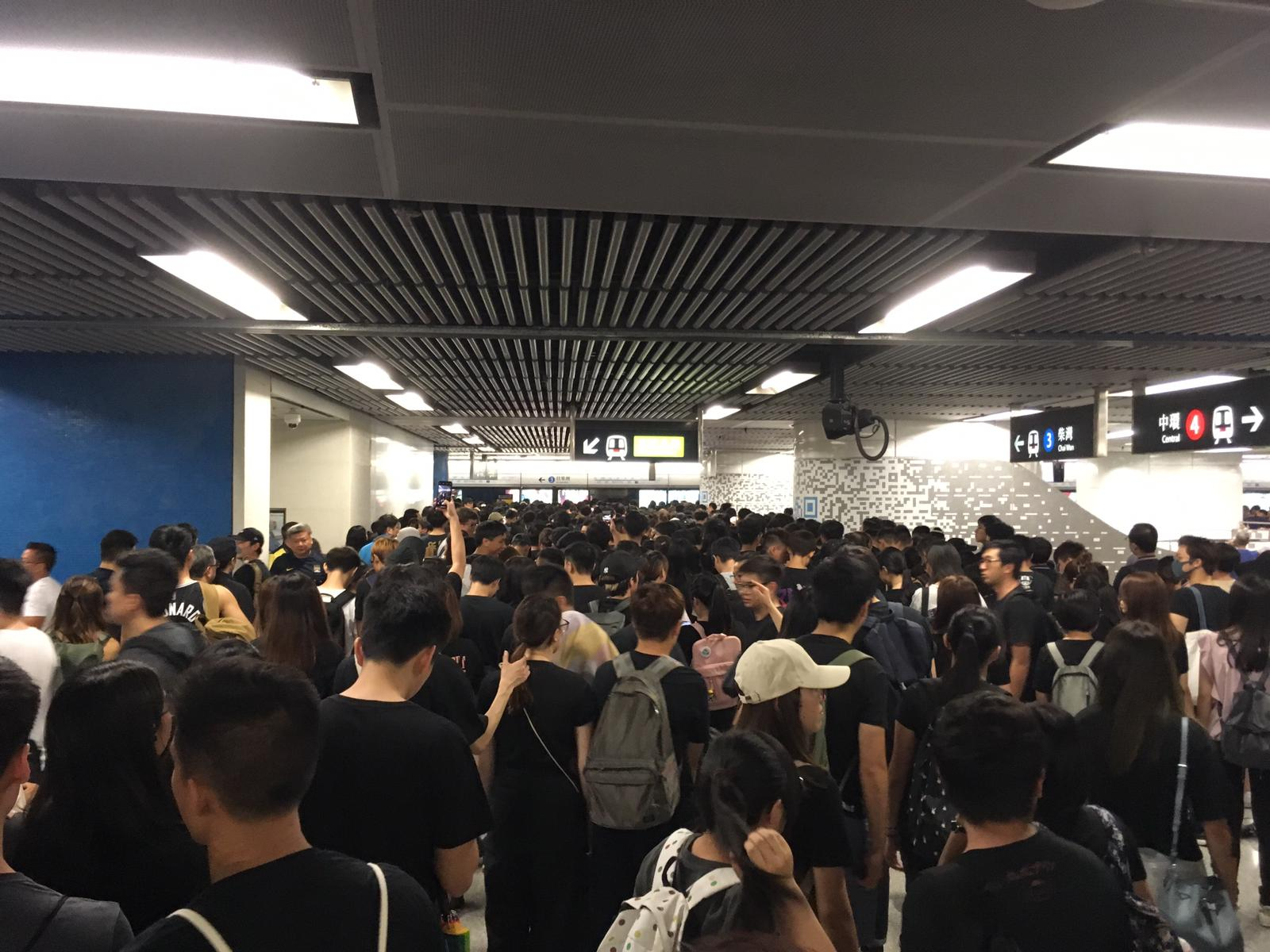 Protesters queue for the eastbound Island Line at Admiralty station in Hong Kong
