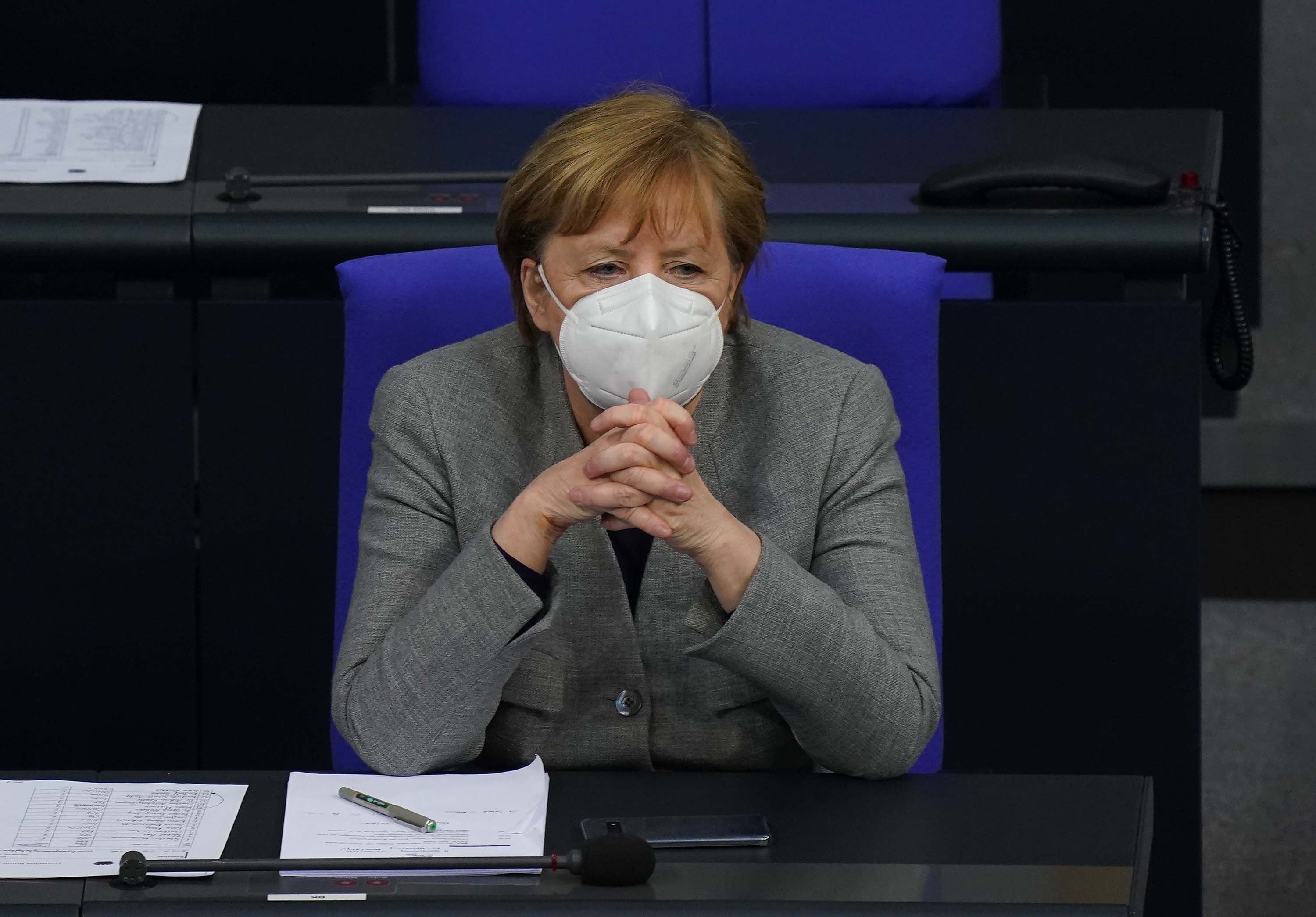 German Chancellor Angela Merkel attends debates at the Bundestag on Germany's recent rollout of coronavirus vaccinations on January 13, in Berlin, Germany.