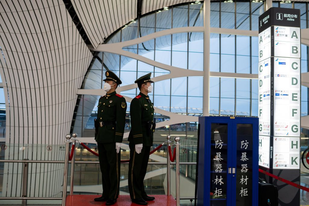 Chinese paramilitary police officers at Daxing international airport in Beijing on February 14.
