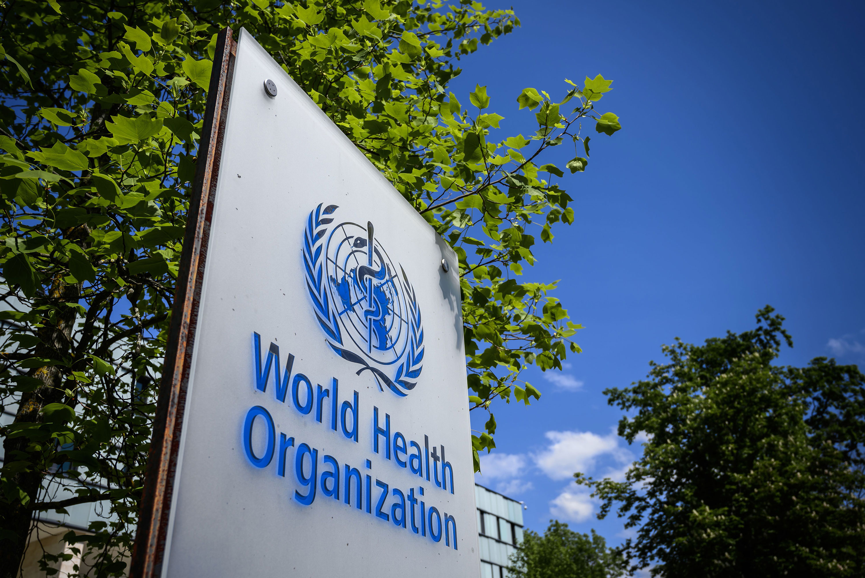 A World Health Organization sign is seen outside of their headquarters in Geneva, Switzerland, in April.