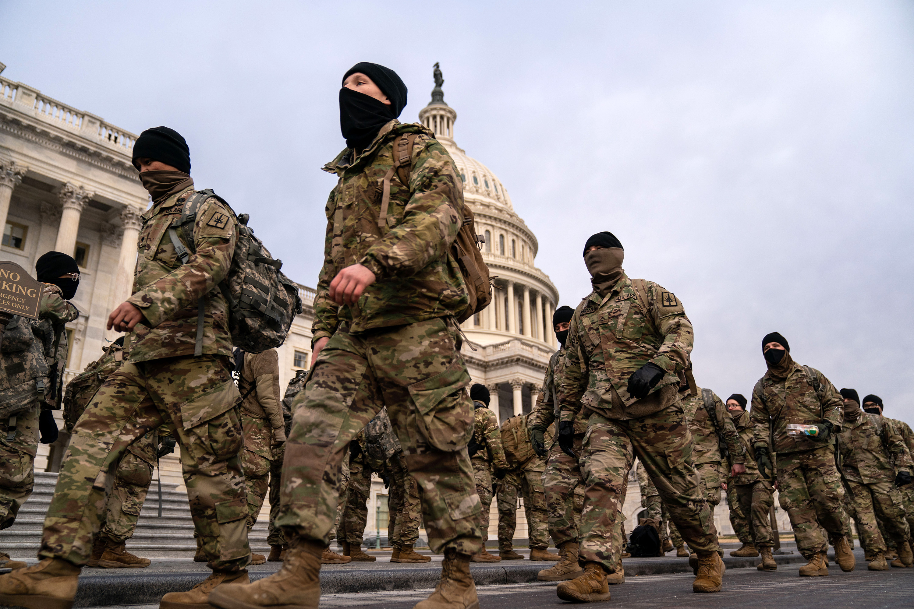 National Guard members are seen outside the US Capitol building on Monday, January 11 in Washington, DC.