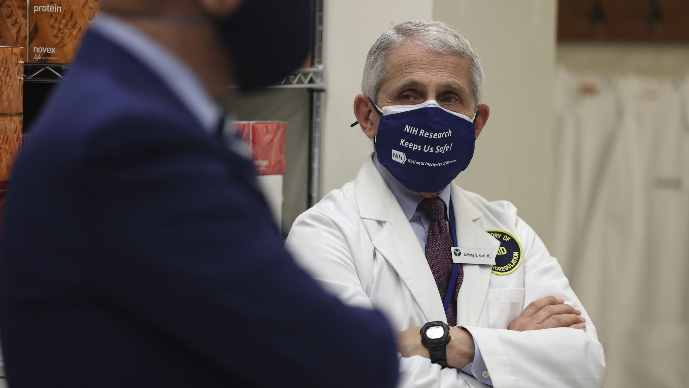 Dr. Anthony Fauci joins President Joe Biden while touring the National Institutes of Health on February 11.