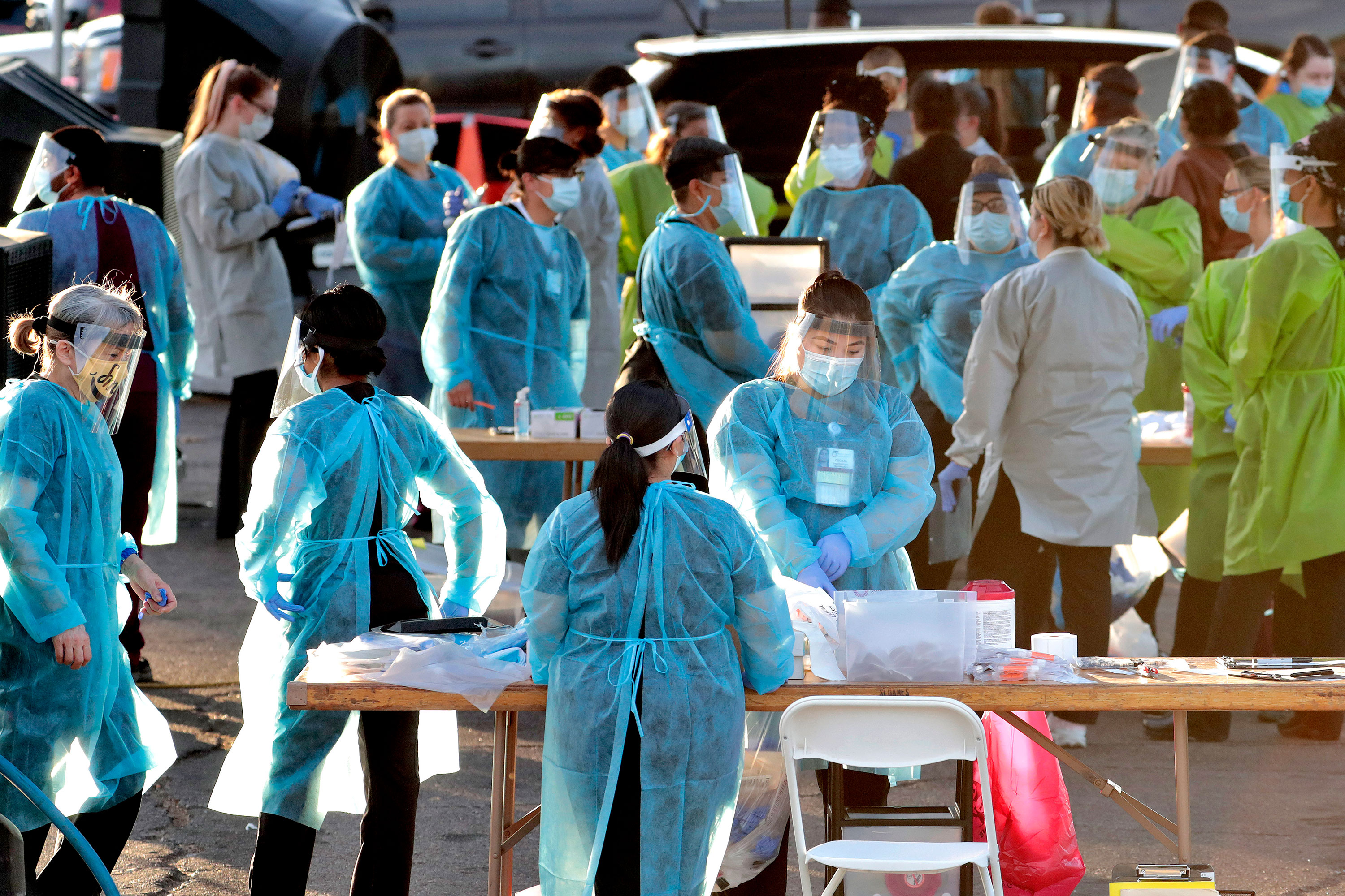Medical personnel prepare to administer hundreds of coronavirus tests on June 27 in Phoenix, Arizona.