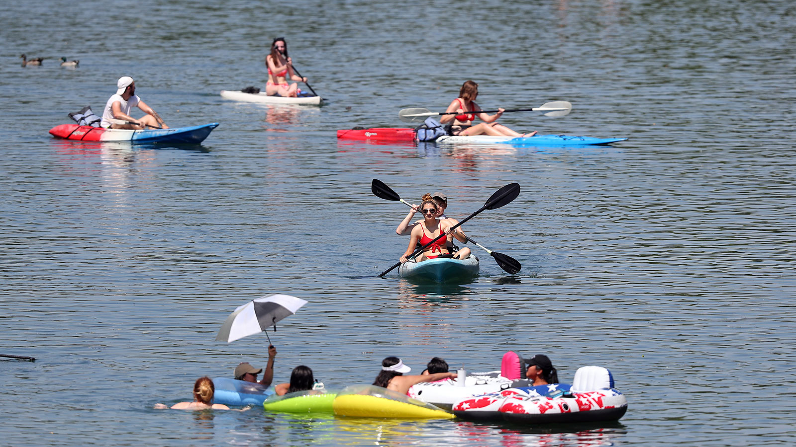 Residents swim, paddle board and kayak in Barton Creek in Austin, Texas on May 20.