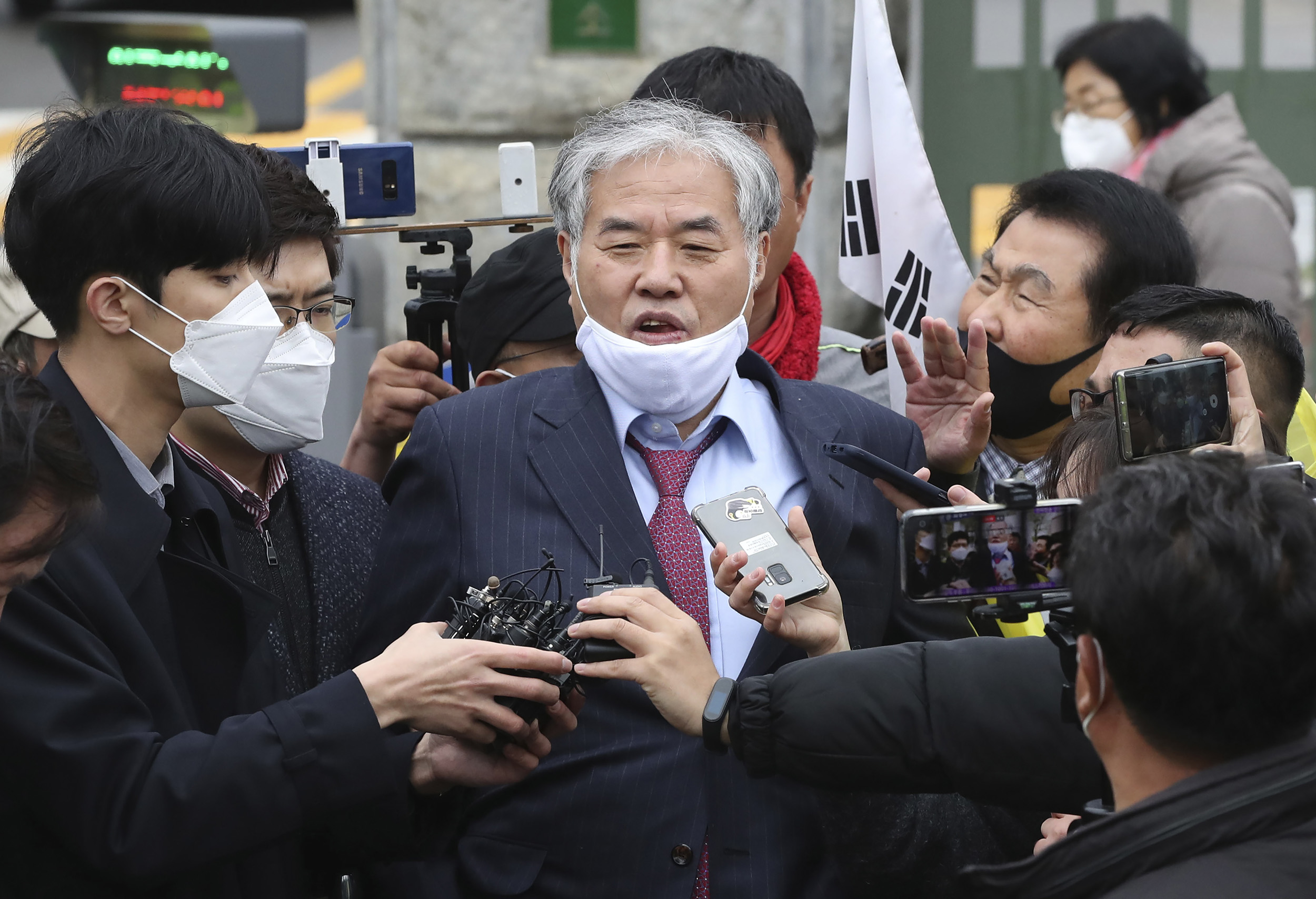 Sarang-jeil Church pastor Jun Kwang-hoon speaks outside a detention center in Uiwang, South Korea, on April 20.
