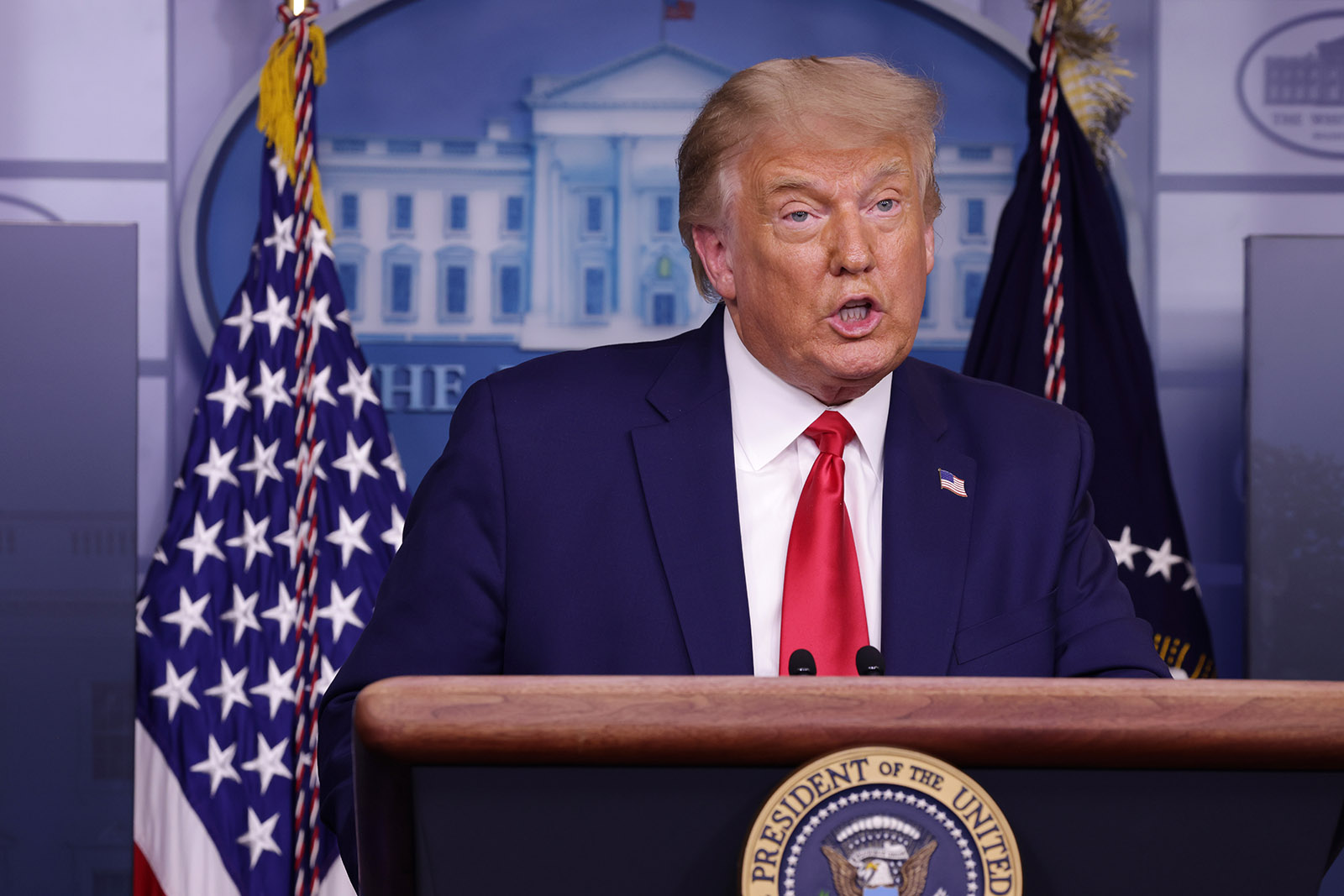 President Donald Trump speaks to the press during a news conference in the White House on Wednesday in Washington.