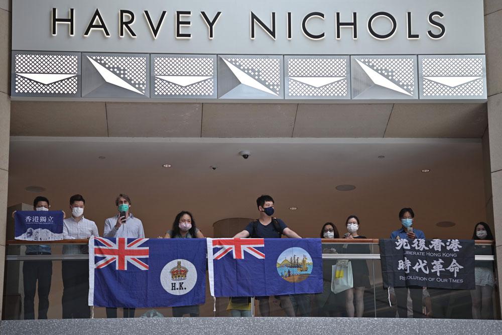 Pro-democracy protestors observe social distancing measures as th