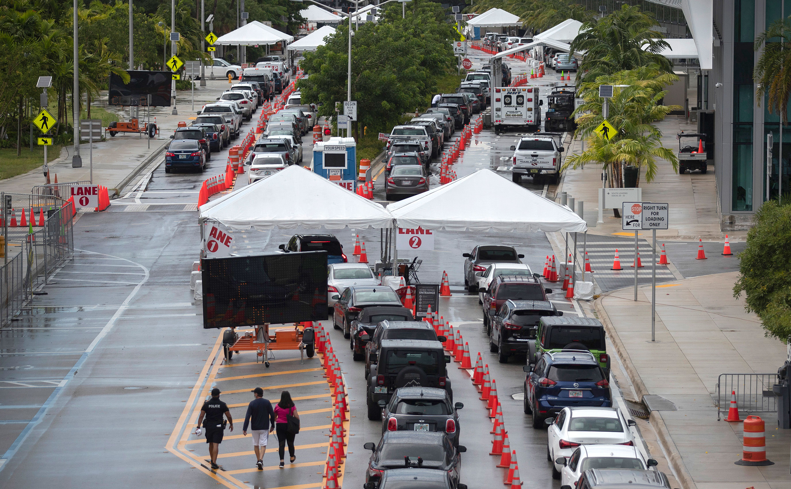 Drivers wait to be tested for Covid-19 at a testing site on July 13 in Miami Beach, Florida.