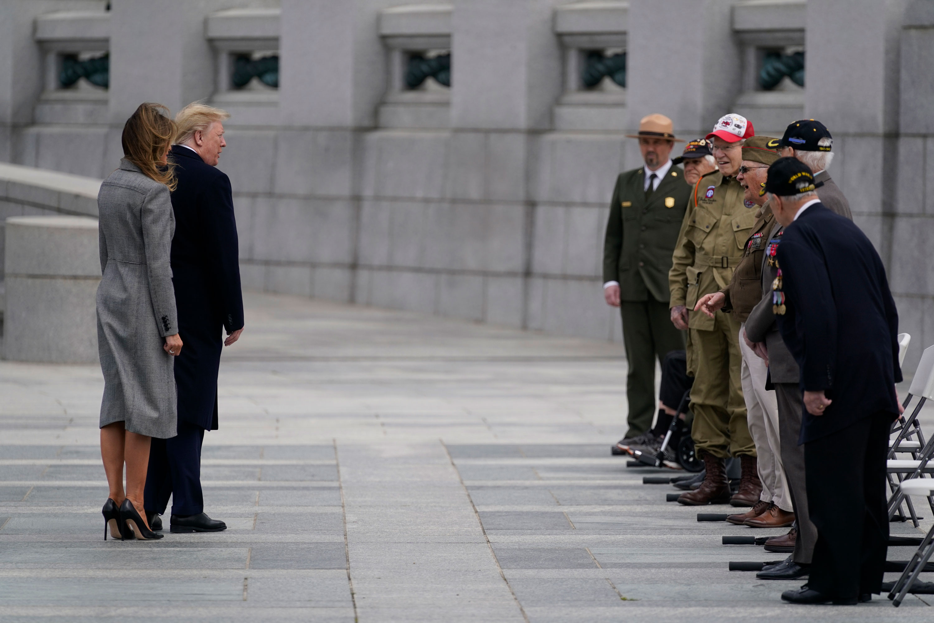 President Donald Trump and first lady Melania Trump greet veterans during a ceremony at the World War II Memorial to commemorate the 75th anniversary of Victory in Europe Day, on May 8, in Washington.