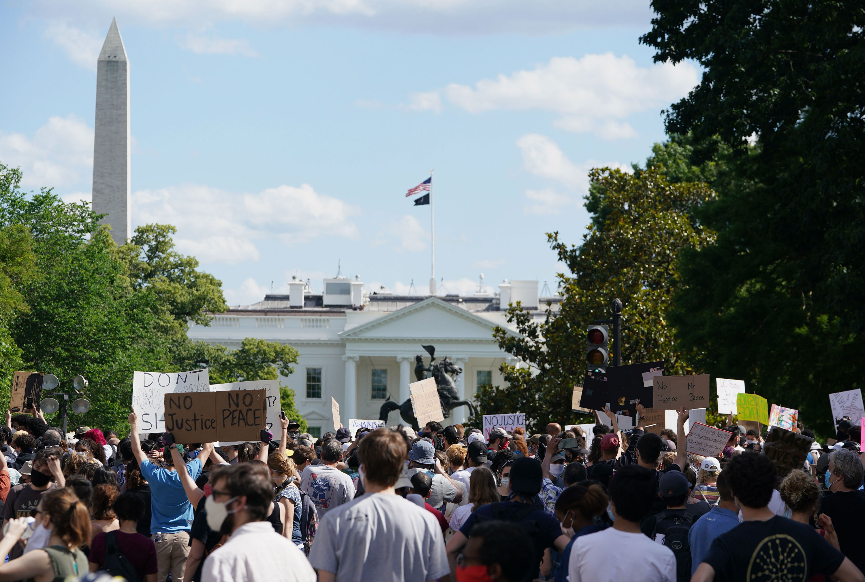 Demonstrators gather near the White House on May 31 in Washington.