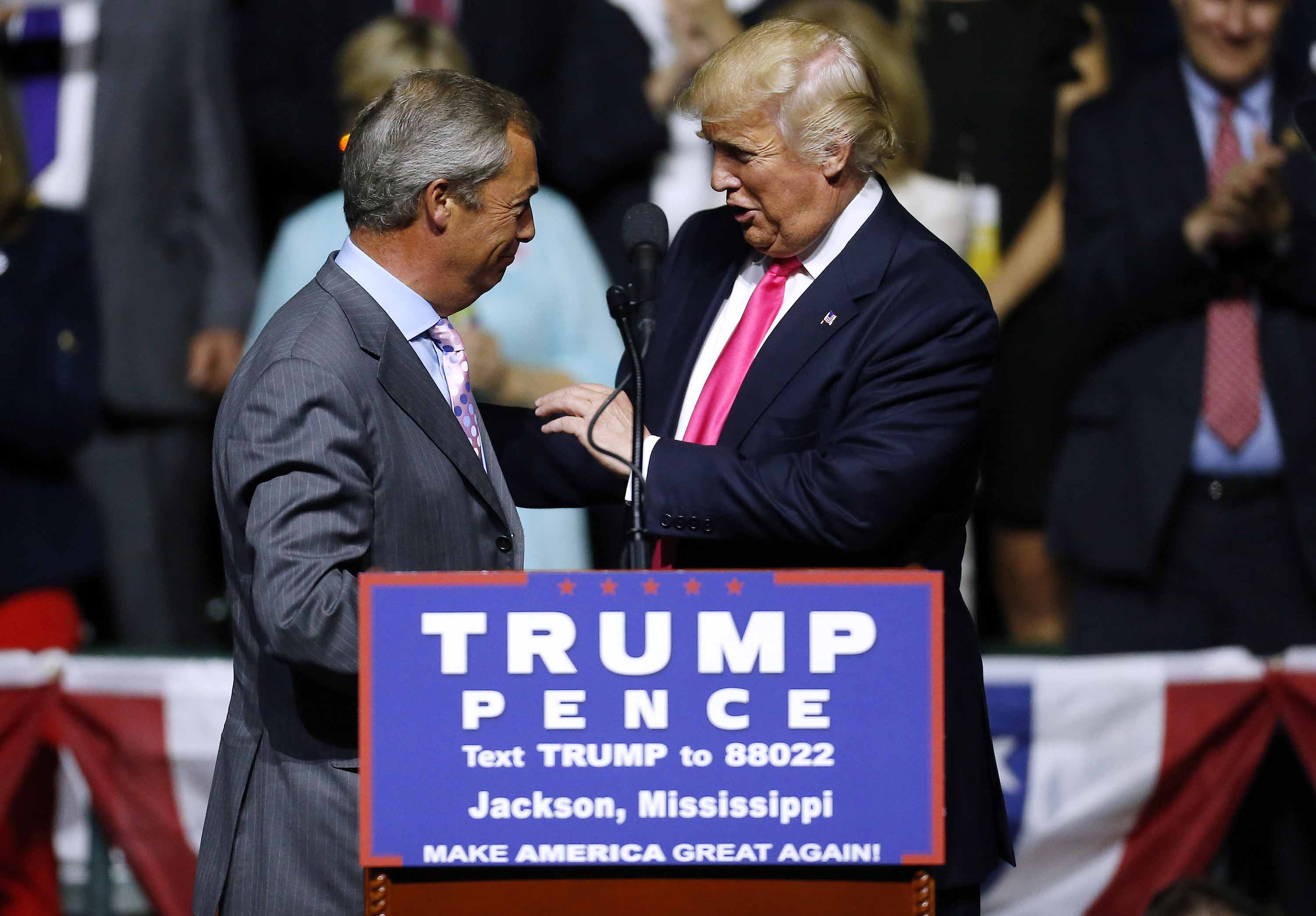 Then-Republican presidential nominee Donald Trump greets Nigel Farage during a campaign rally in Jackson, Mississippi in August 2016. Photo: Jonathan Bachman/Getty Images
