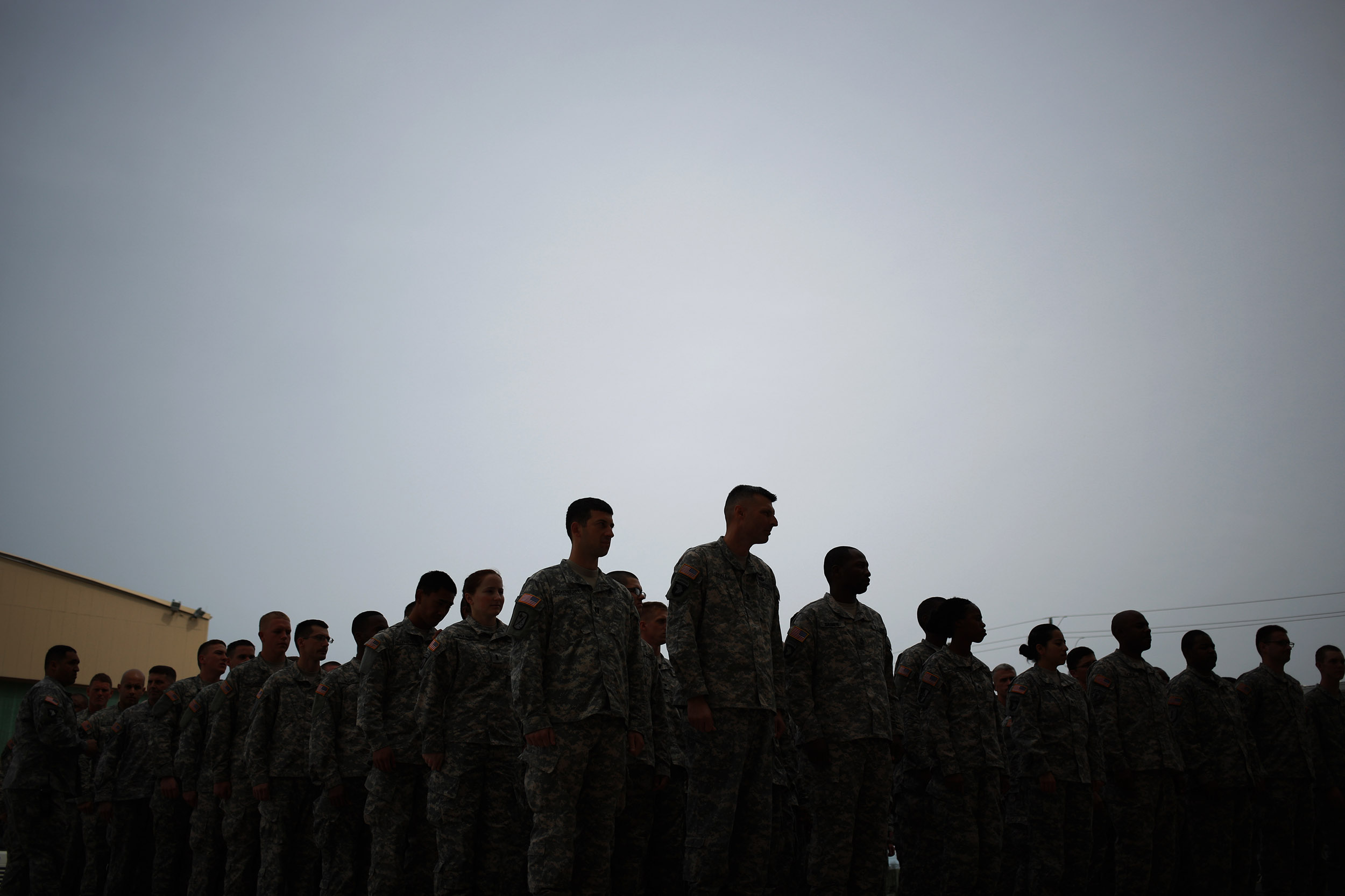 Soldiers from the U.S. Army's 101st Airborne Division stand in formation before marching in a homecoming ceremony at Fort Campbell, Kentucky, on March 21, 2015.