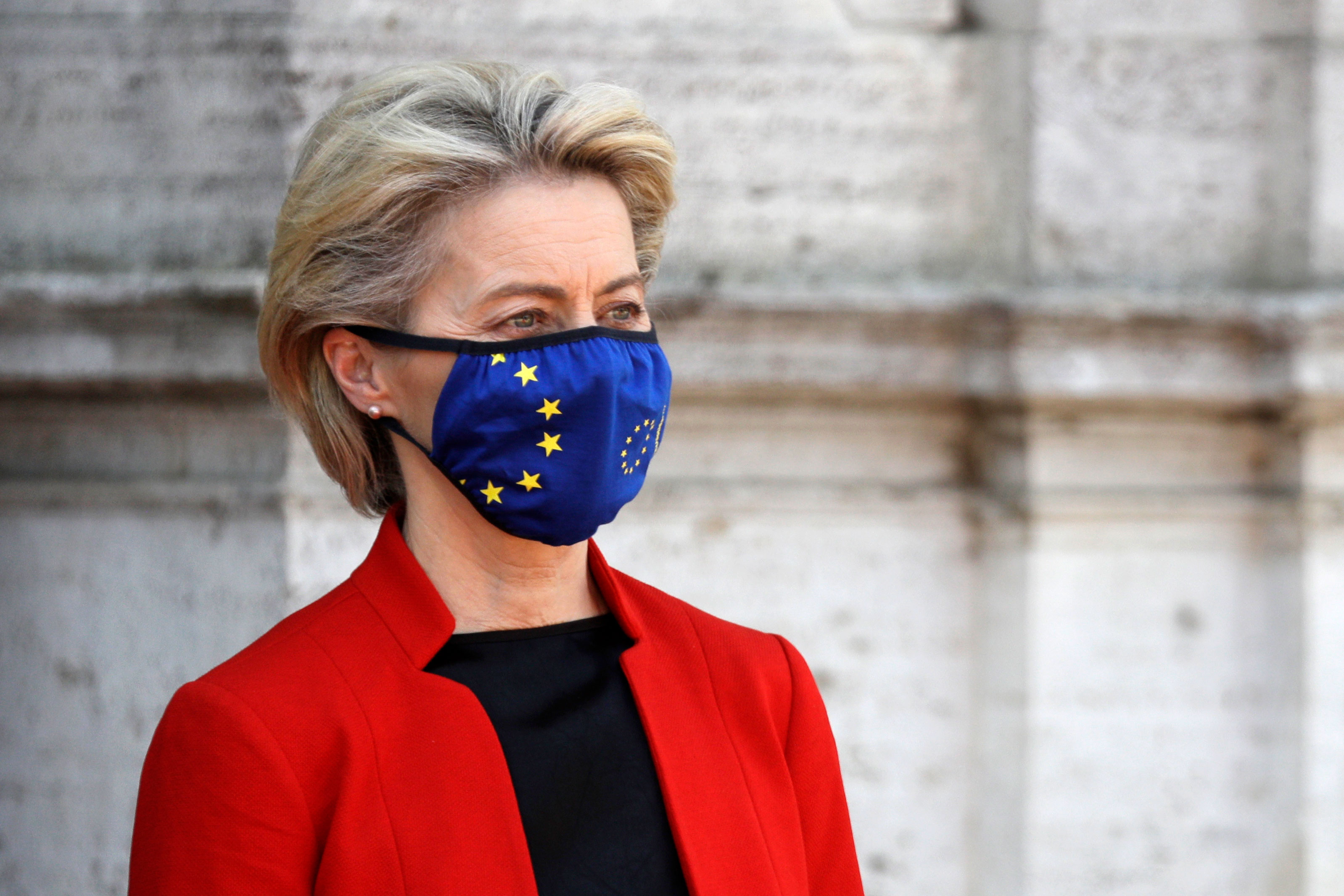 European Union Commission President Ursula von der Leyen stands after reviewing the honor guard during the Global Health Summit in Rome on May 21.