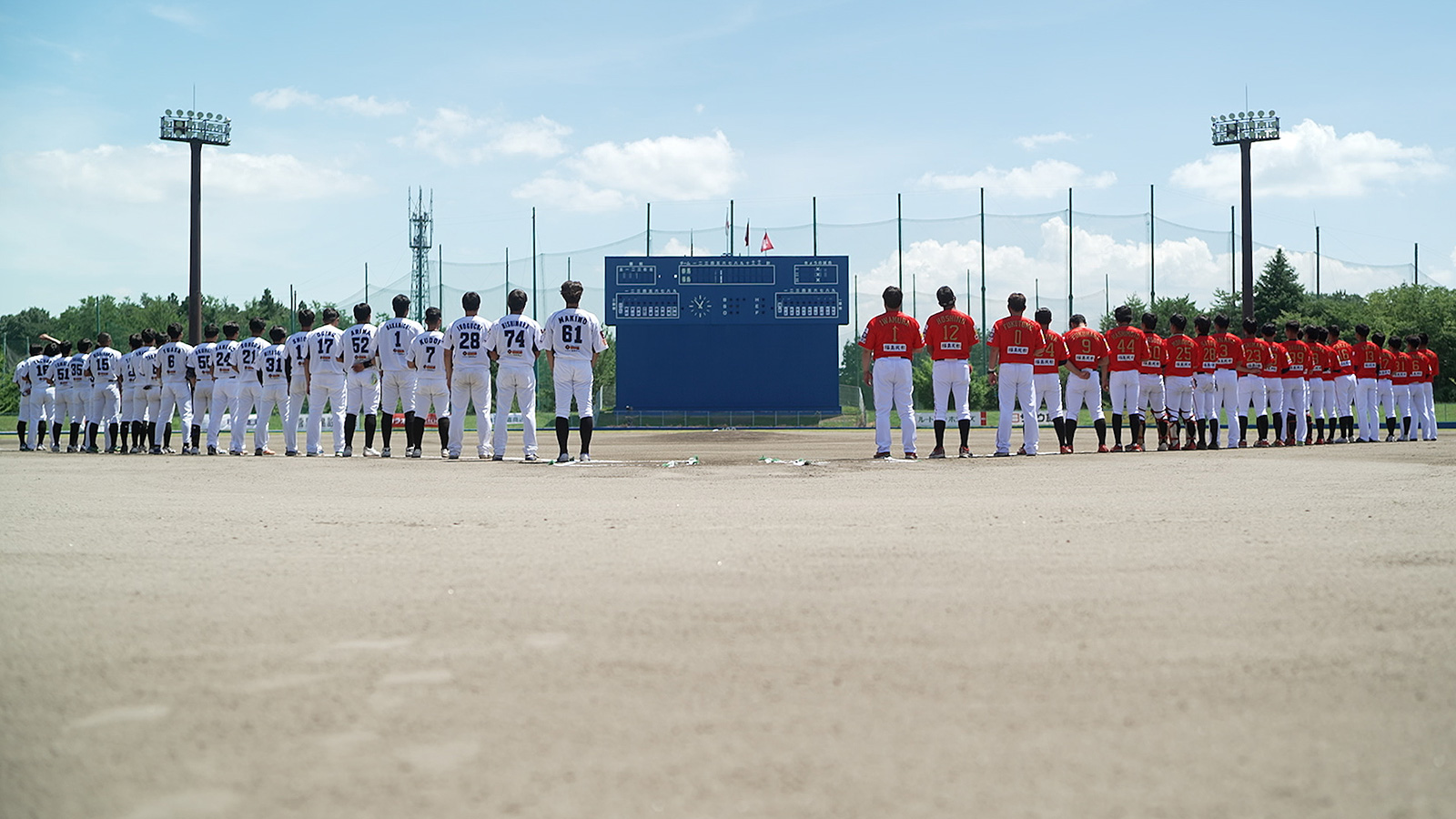 The Red Hopes Fukushima prepare to play a game against a team from Gunma at a stadium in Izumizaki village in Fukushima prefecture.