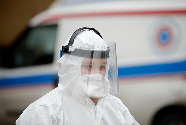 A health worker outside a hospital in Warsaw, Poland, on Wednesday.
