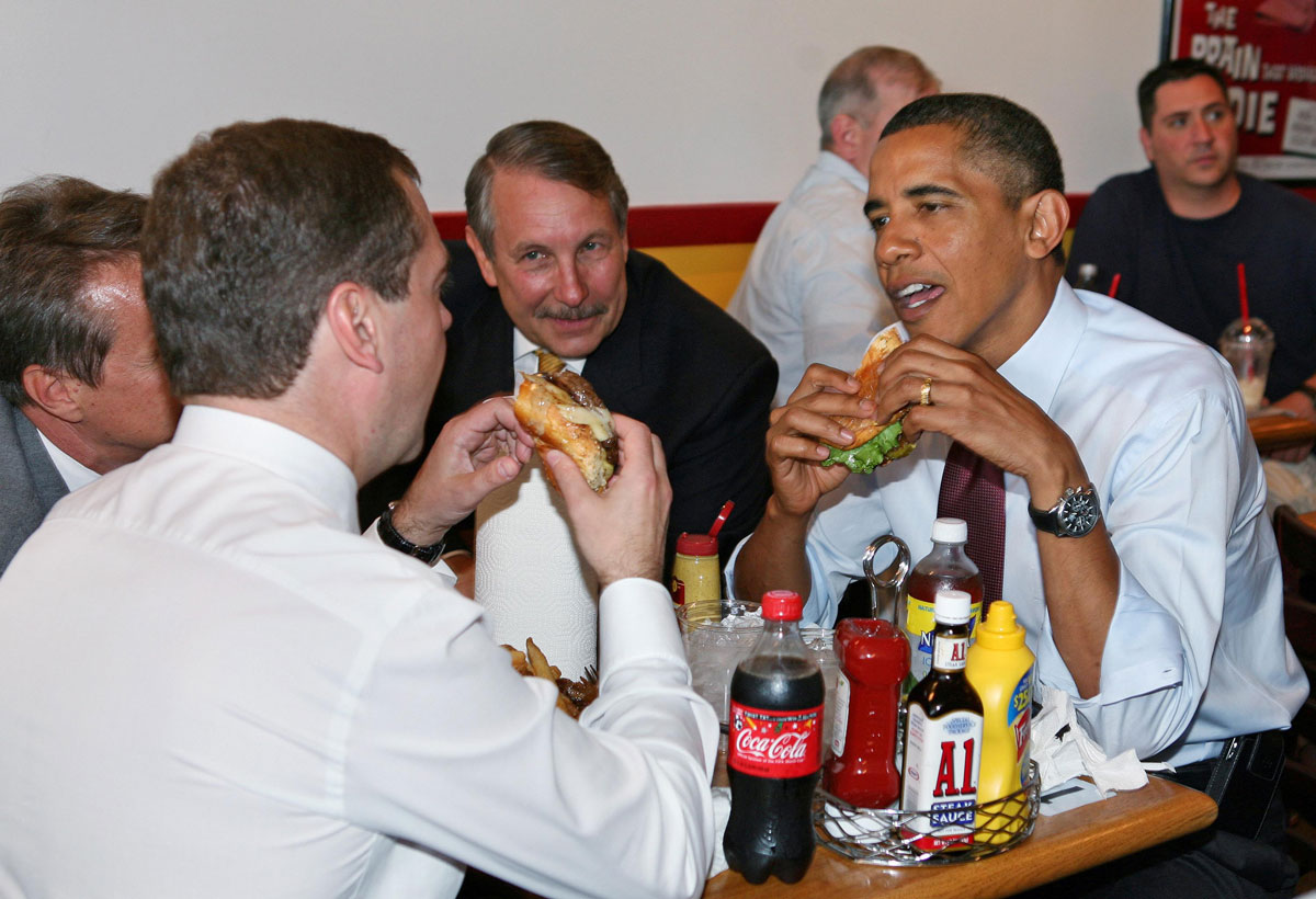 Obama and Medvedev eat cheeseburgers in Arlington, Virginia, in 2010. Earlier, they met in the White House Oval Office.