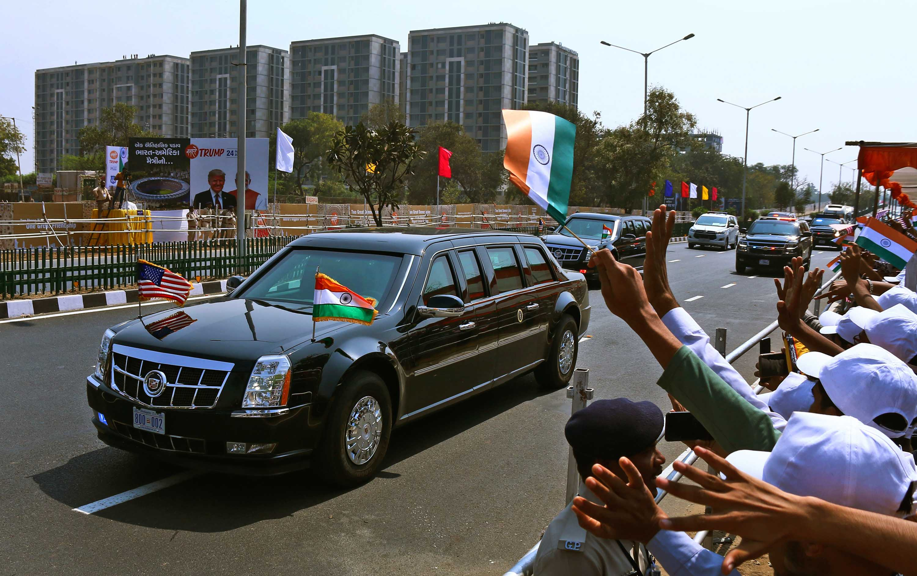 Indians wave at President Trump's motorcade in Ahmedabad, India, on Monday.
