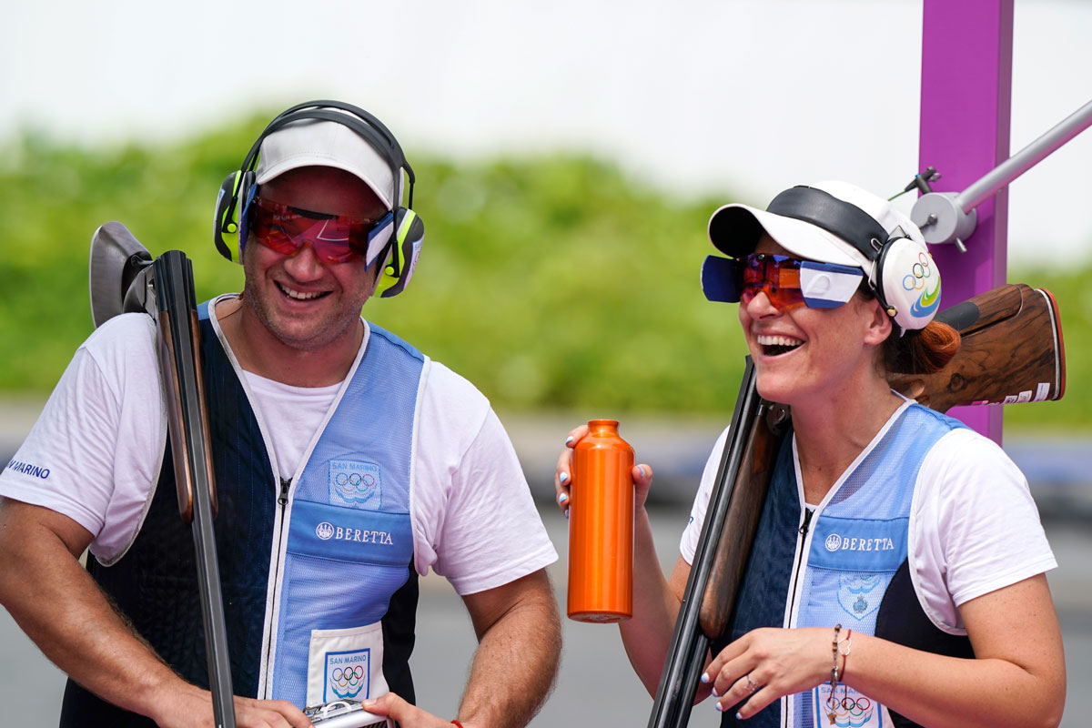San Marino's Gian Marco Berti, left, and Alessandra Perilli smile after competing in the mixed team trap at the Asaka Shooting Range.
