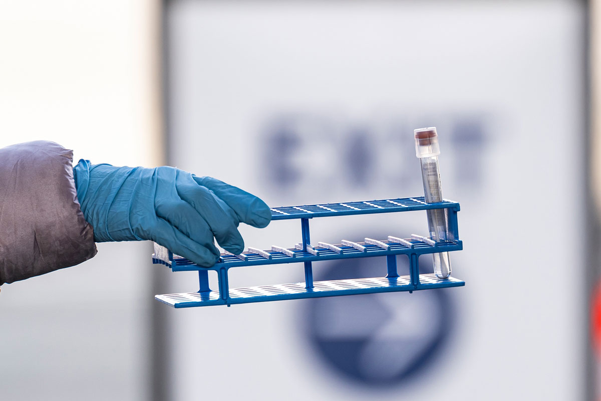 A health care worker collects a Covid-19 swab test at a United Airlines drive-thru testing site inside San Francisco International Airport on January 9.