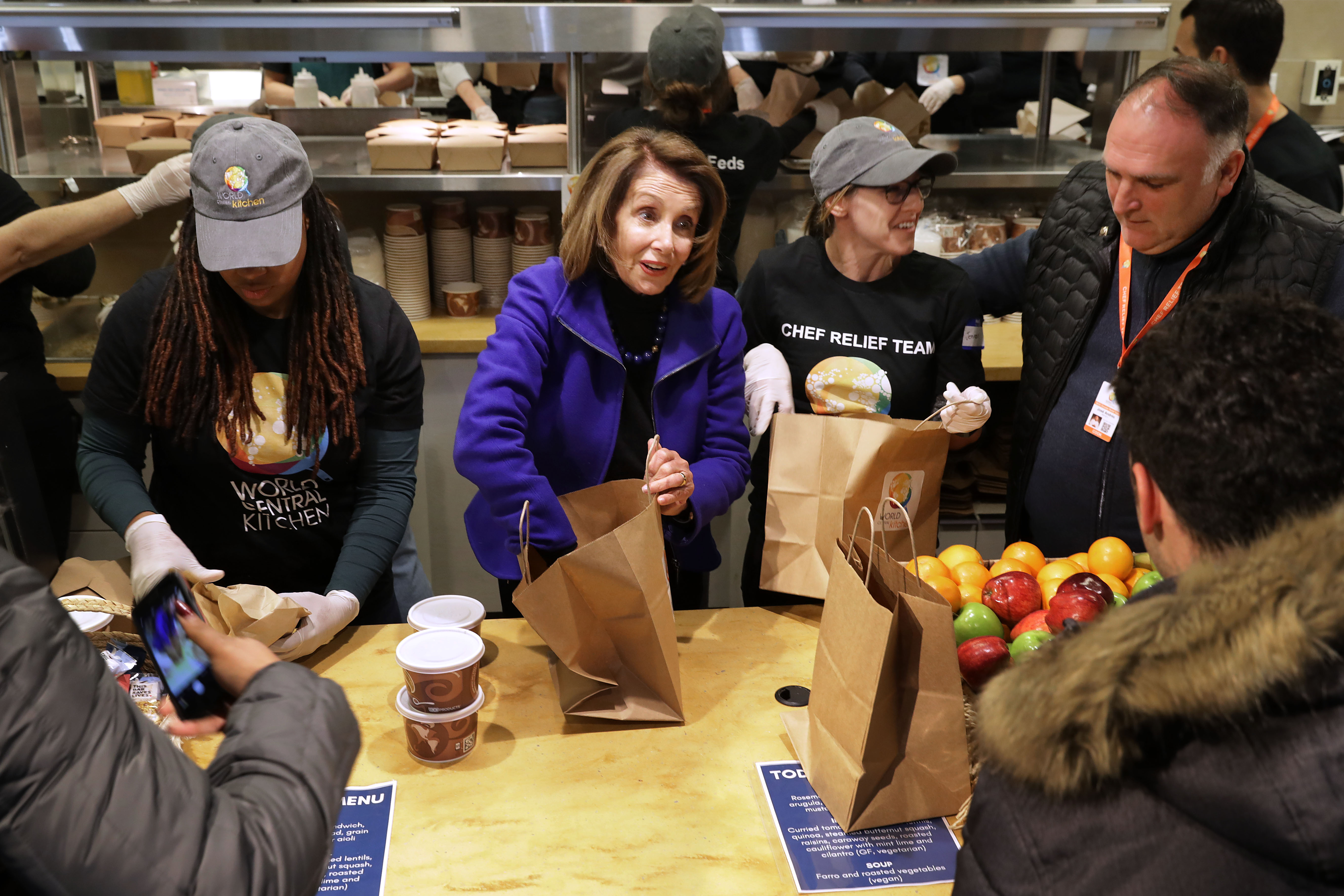 Speaker of the House Nancy Pelosi and chef Jose Andres help distribute food to furloughed federal workers at the World Central Kitchen on Jan. 22.