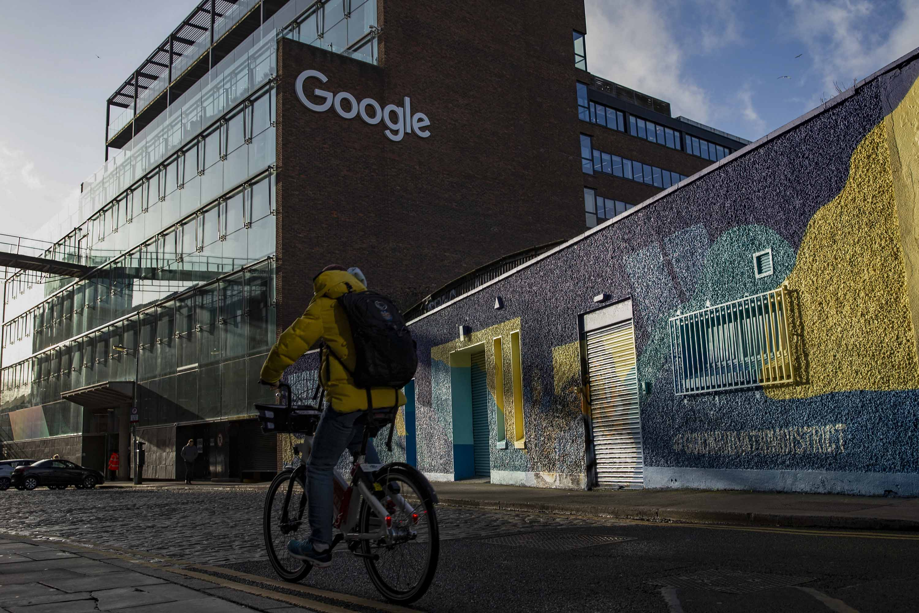A cyclist passes the European headquarters building of Google Inc. in Dublin, Ireland, on January 6.