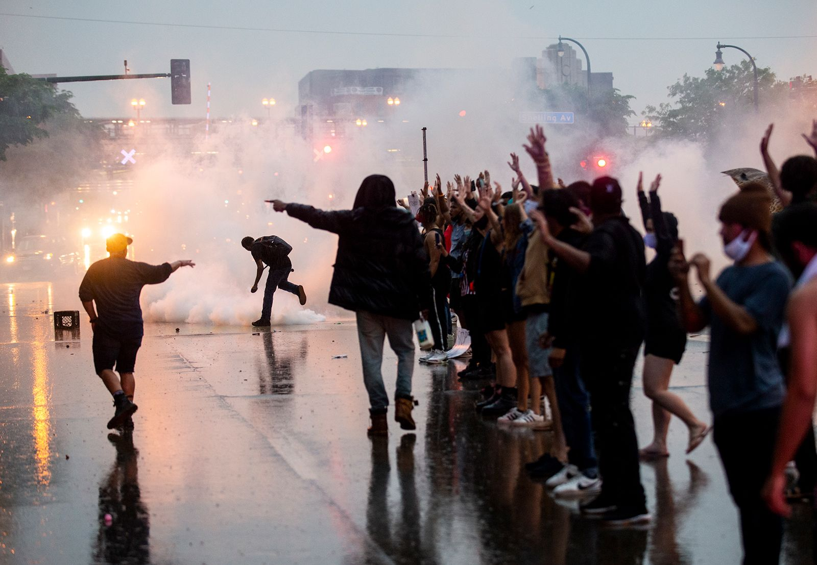 Tear gas is fired as protesters clash with police while demonstrating outside the 3rd Precinct.