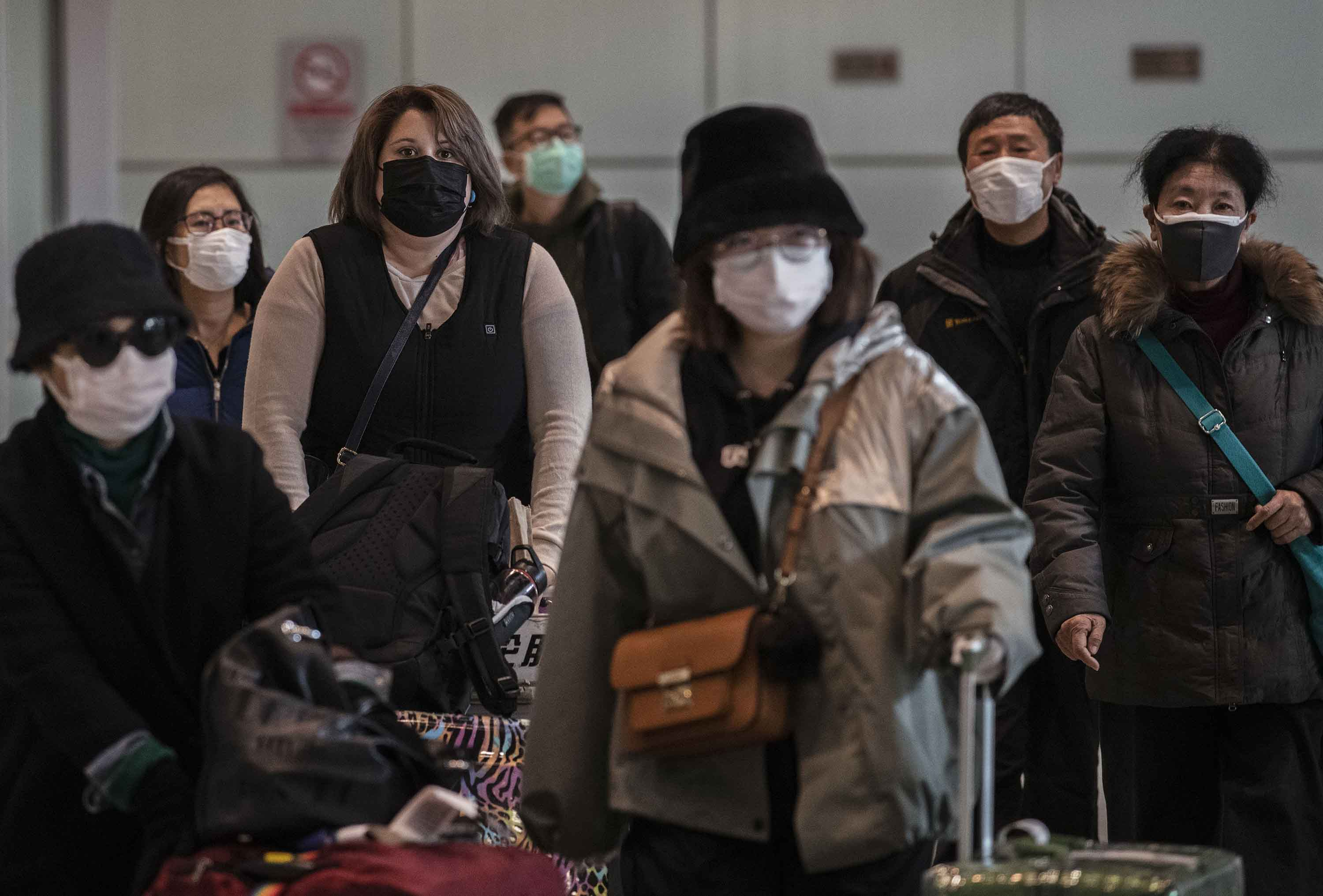 Passengers were wearing protective masks at Beijing Capital Airport in Beijing, China on Thursday.
