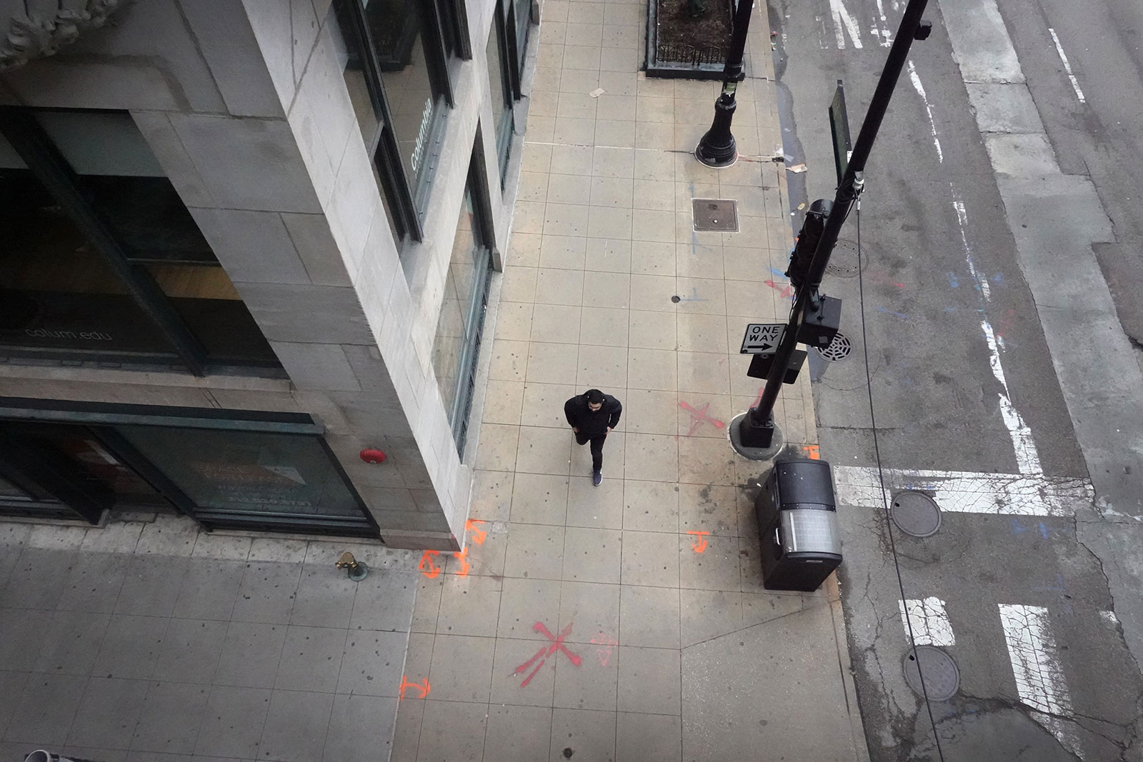A person walks down a sidewalk in Chicago, Illinois, on March 20.