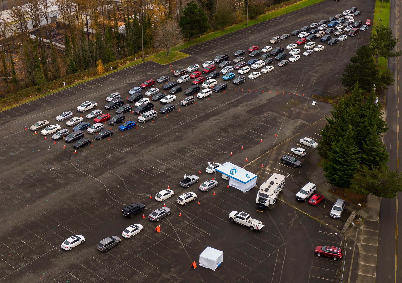 Cars line up during a Covid-19 testing and flu shot event at the Tacoma Dome in Tacoma, Washington, on November 28.