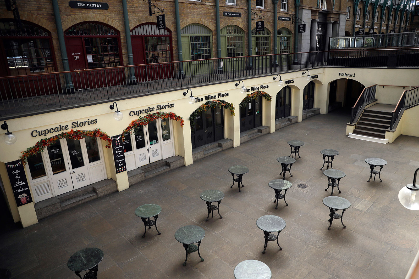 Tables stand empty, as restaurants and bars are closed due to the lockdown to try to stop the spread of coronavirus, in the south hall of Covent Garden, central London on April 20.