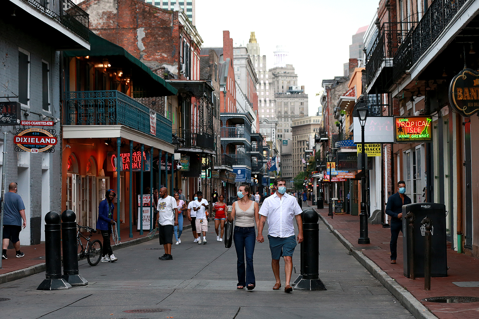 Pedestrians are seen walking along Bourbon Street in the French Quarter on July 14,  in New Orleans.