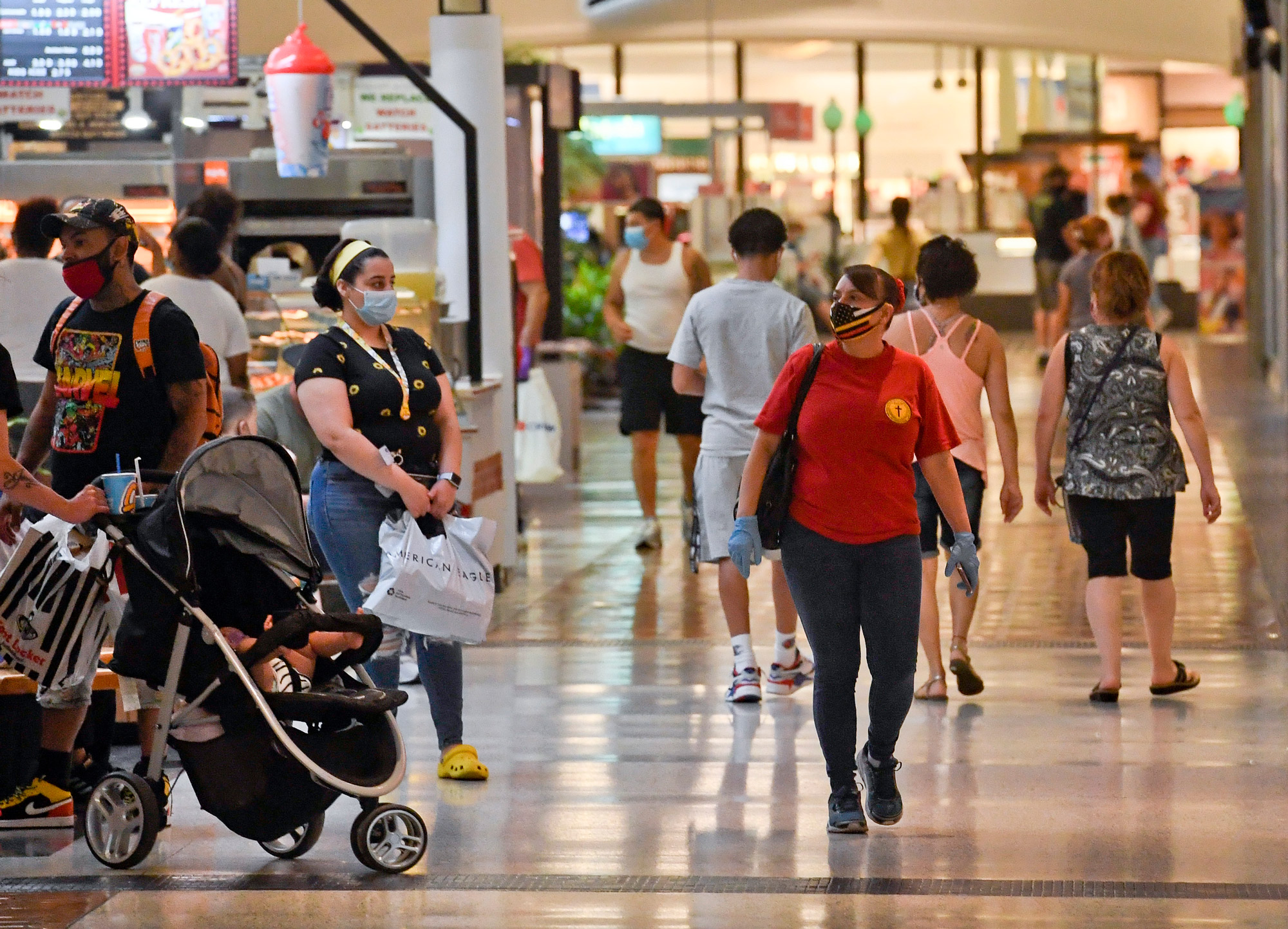 People walk through the concourse at the Berkshire Mall in Wyomissing, Pennsylvania, on June 26.