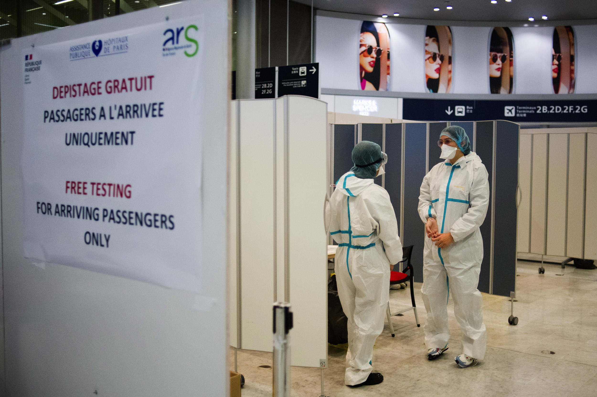 Health workers wait for travelers at the Covid-19 tests center at Charles de Gaulle airport in Roissy, France, on Tuesday, October 6.