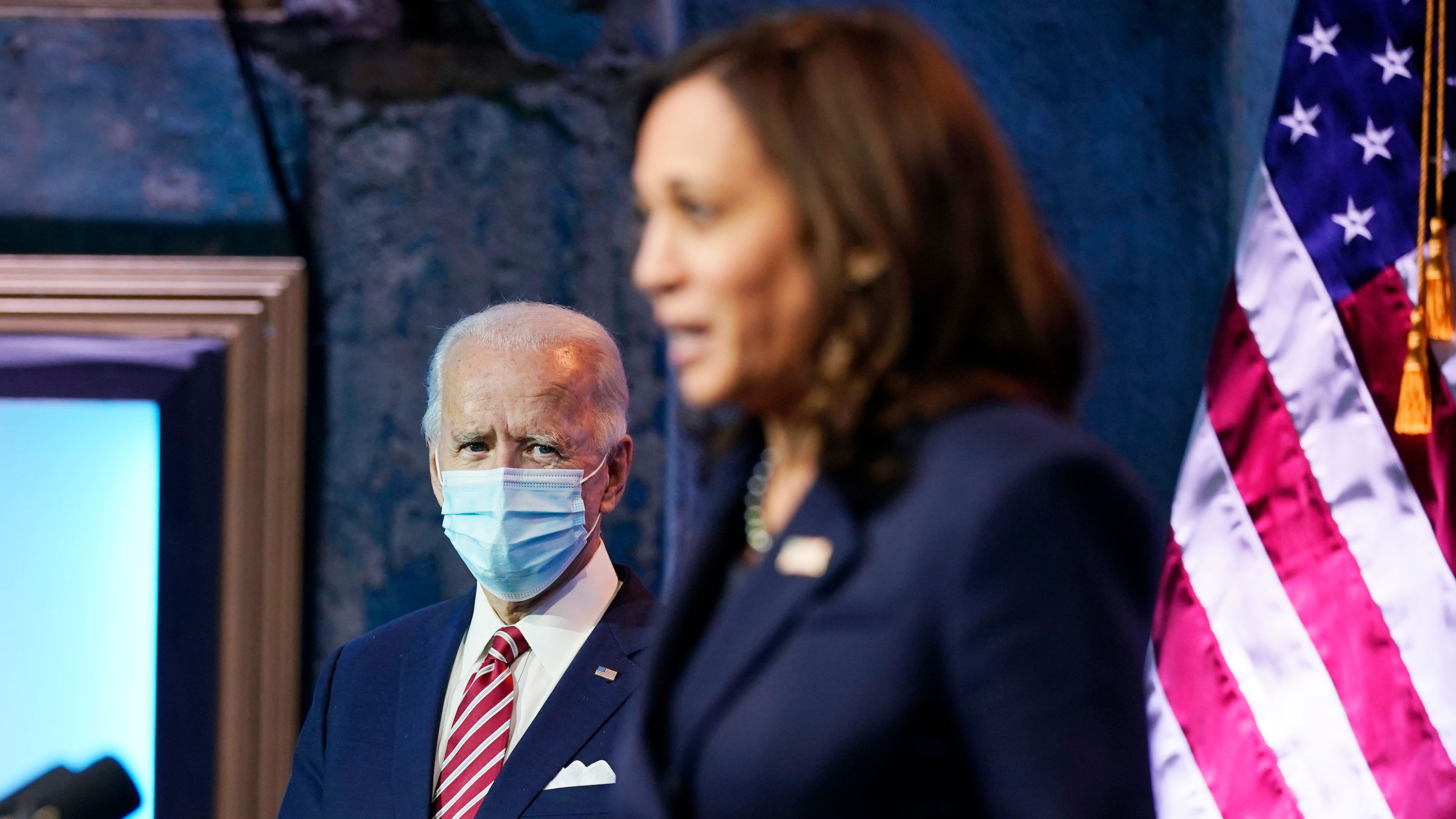 President-elect Joe Biden listens as Vice President-elect Kamala Harris speaks about economic recovery on Monday, November 16 in Wilmington, Delaware.