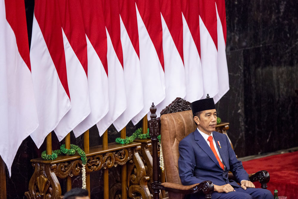In this October 20, 2019 file photo, President Joko Widodo gestures during his inauguration ceremony at the House of Representative building in Jakarta, Indonesia.