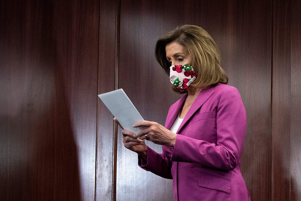 Speaker of the House Nancy Pelosi waits to speak during a press conference on Capitol Hill in Washington on June 16.