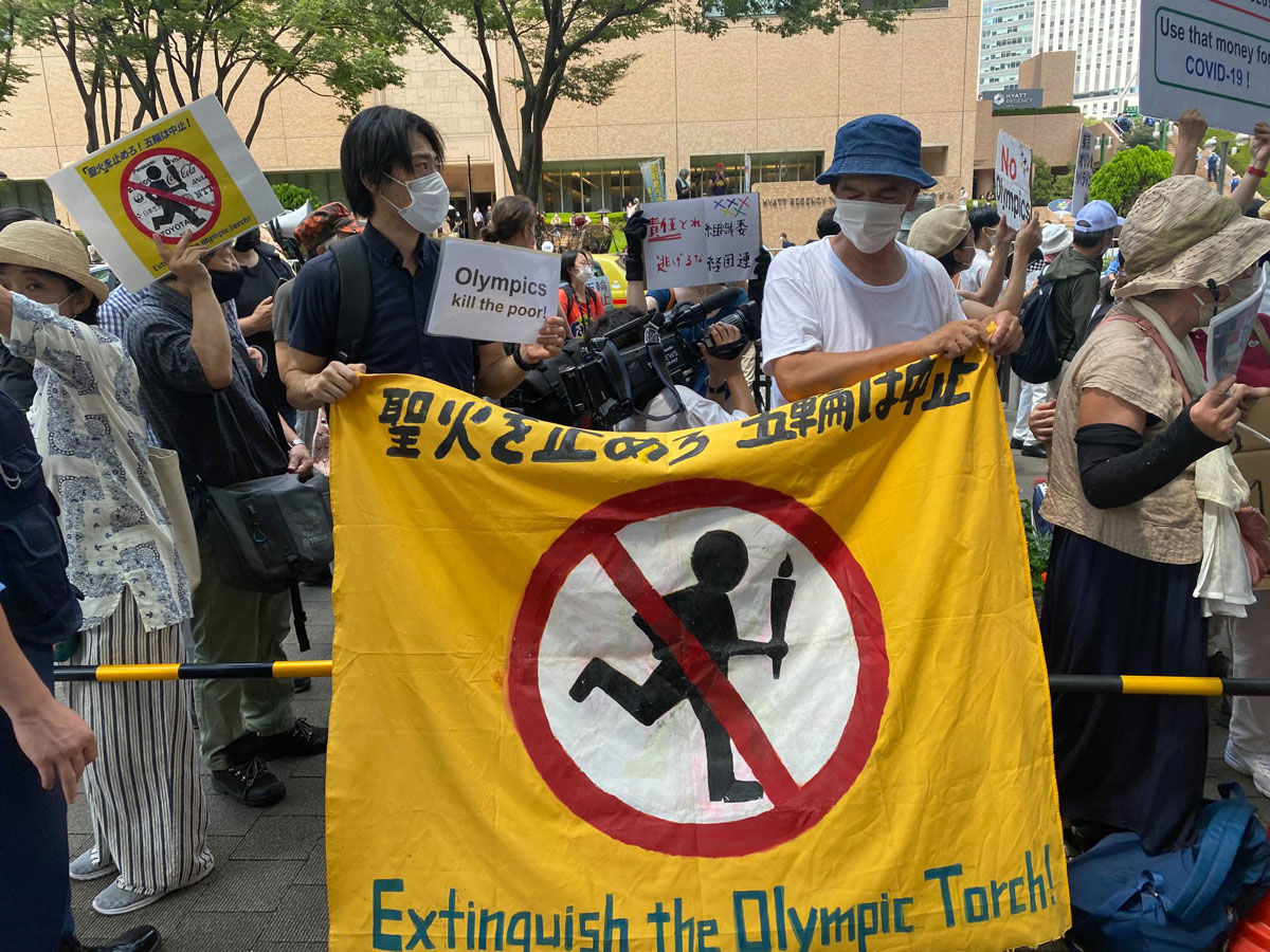 Anti-Olympics protesters gathered in Tokyo ahead of Friday's opening ceremony.