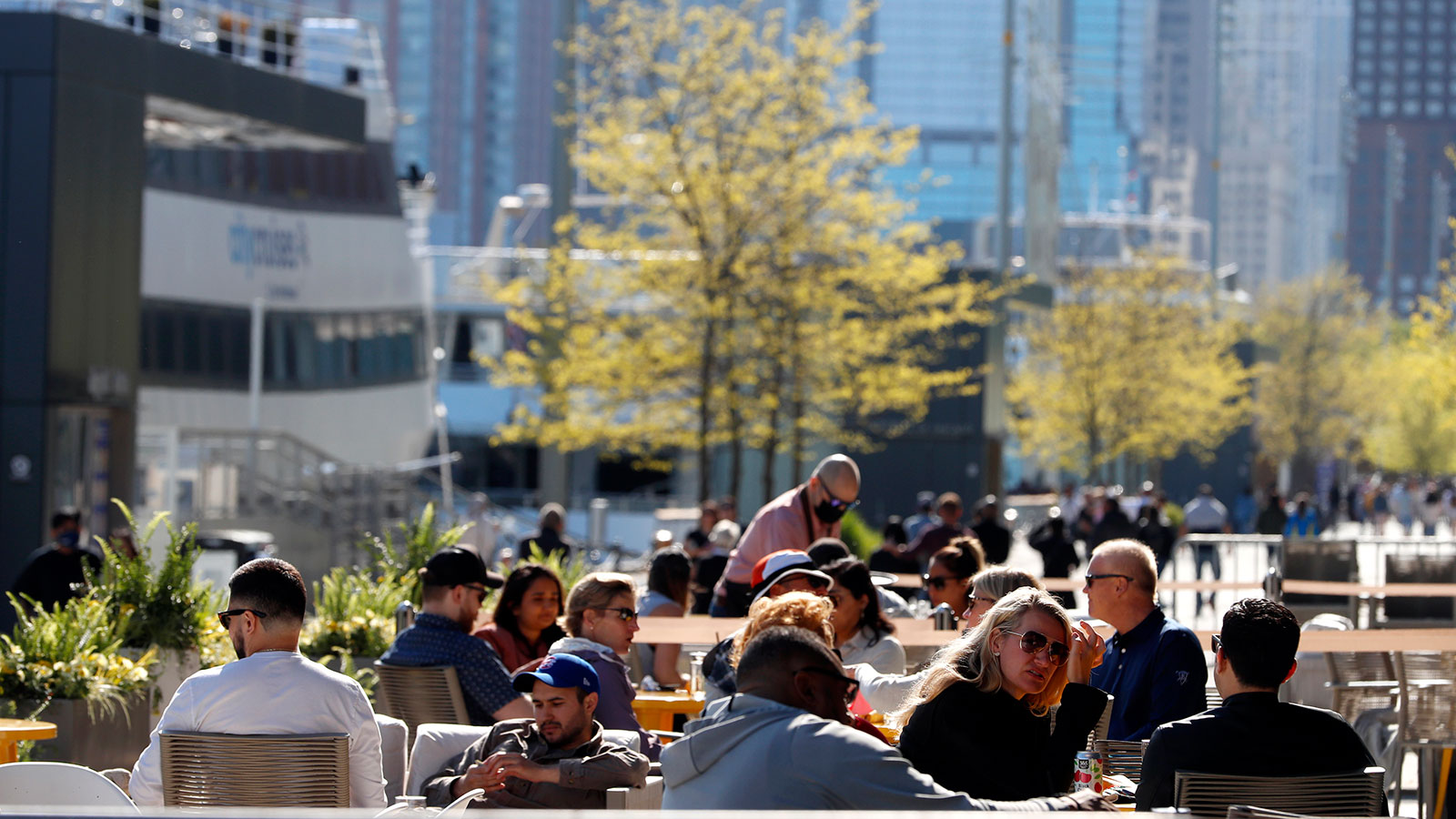 People enjoy their time in an outside sitting area of a restaurant in Chicago's Navy Pier on Friday, May 14.
