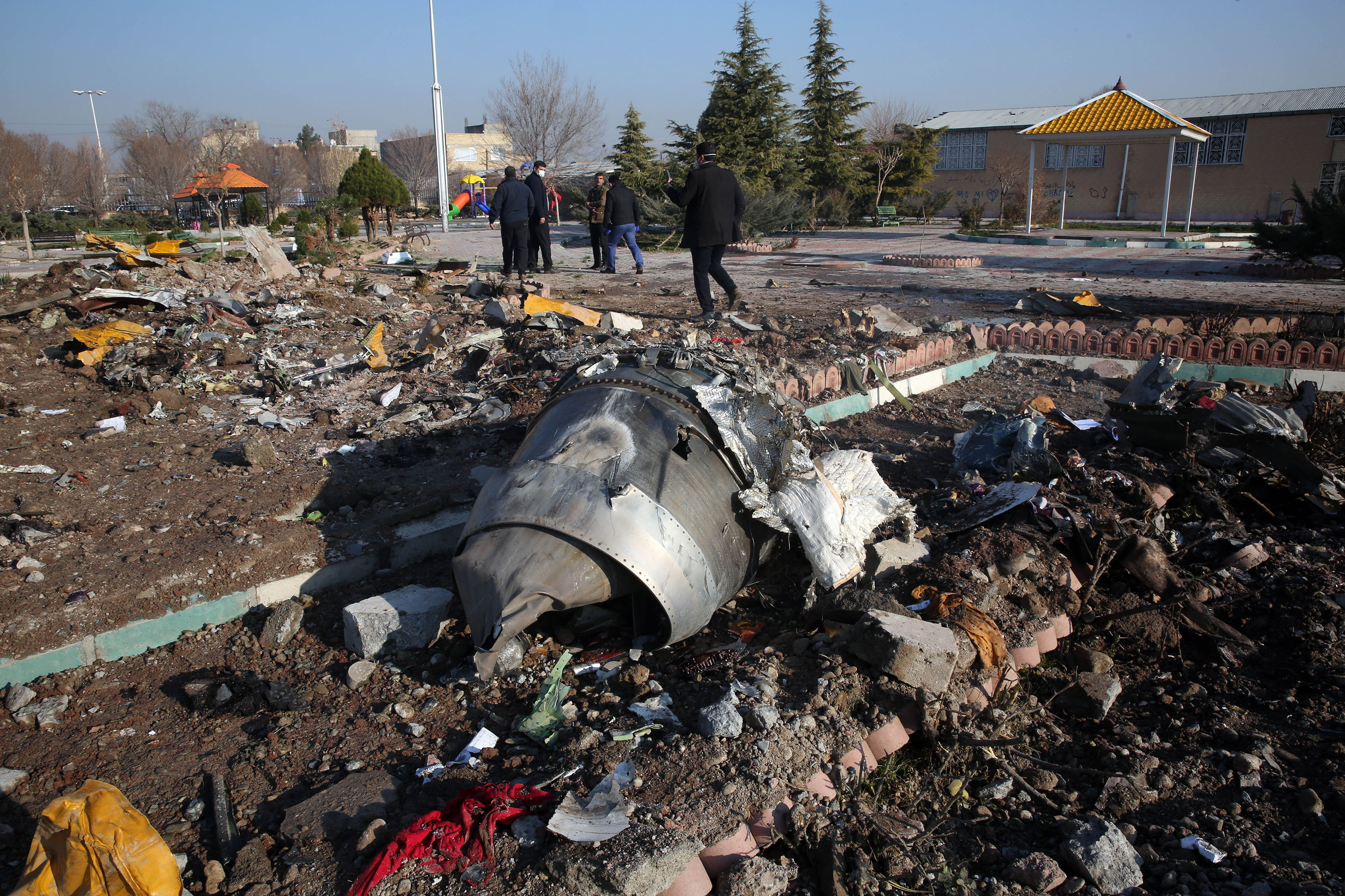 Rescue teams work amidst the debris from the plane crash near Imam Khomeini airport in Tehran, Iran, on January 8.