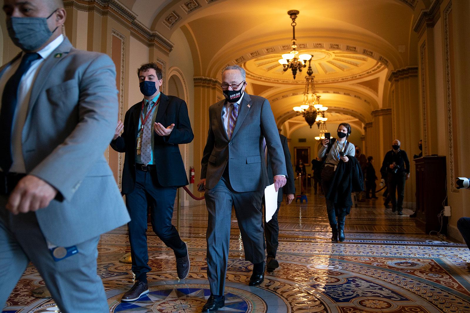 Senate Majority Leader Chuck Schumer walks through the Capitol on Tuesday.