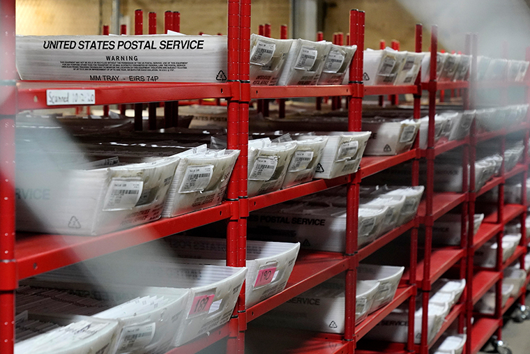 In this Oct. 29, 2020, file photo, a portion of mail-in and absentee ballots that have arrived at the Allegheny County Election Division are kept in a secure area at the Elections warehouse in Pittsburgh, Pennsylvania.