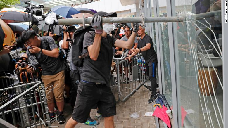 Protesters trying to break into the Legislative Council building in Hong Kong.