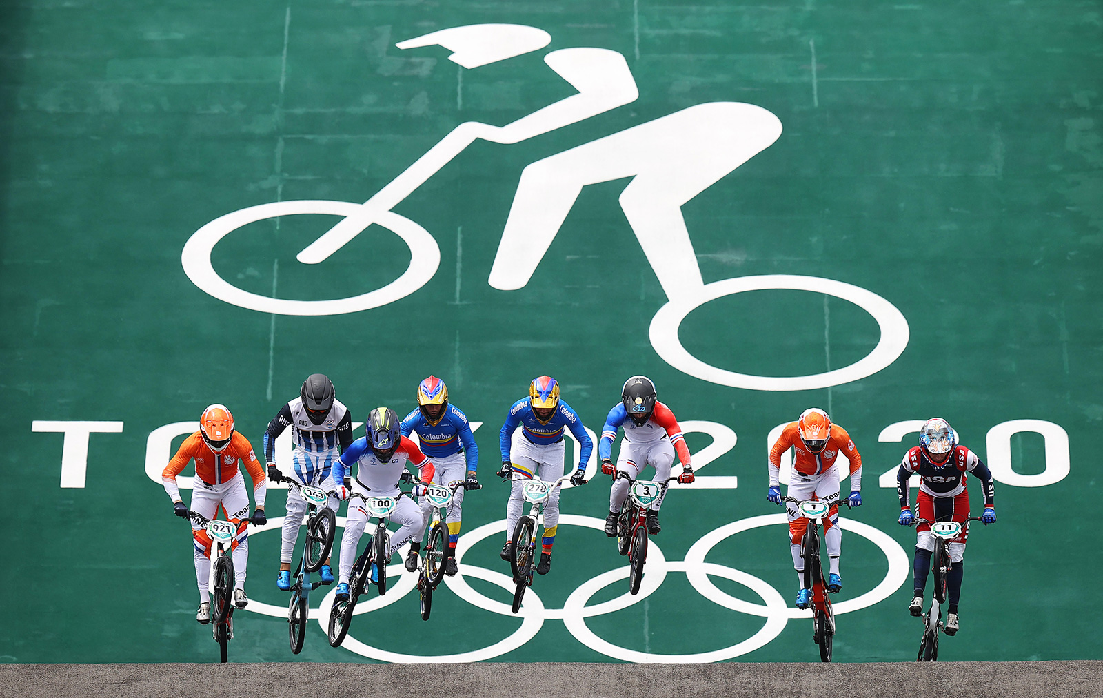 Racers jump during the men's BMX semifinals on Friday in Tokyo.