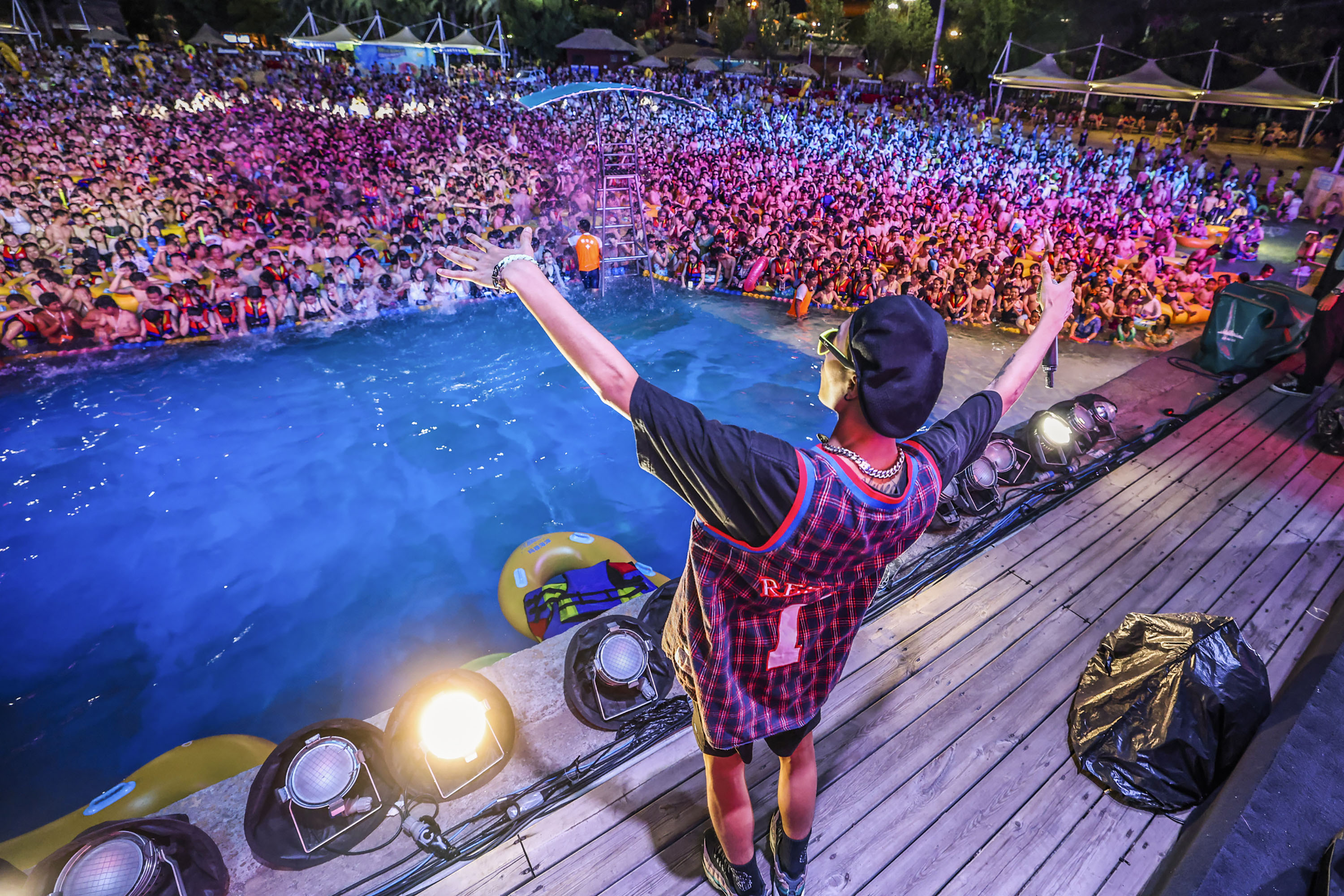 People watch a performance at a water park in Wuhan, China, on August 15.