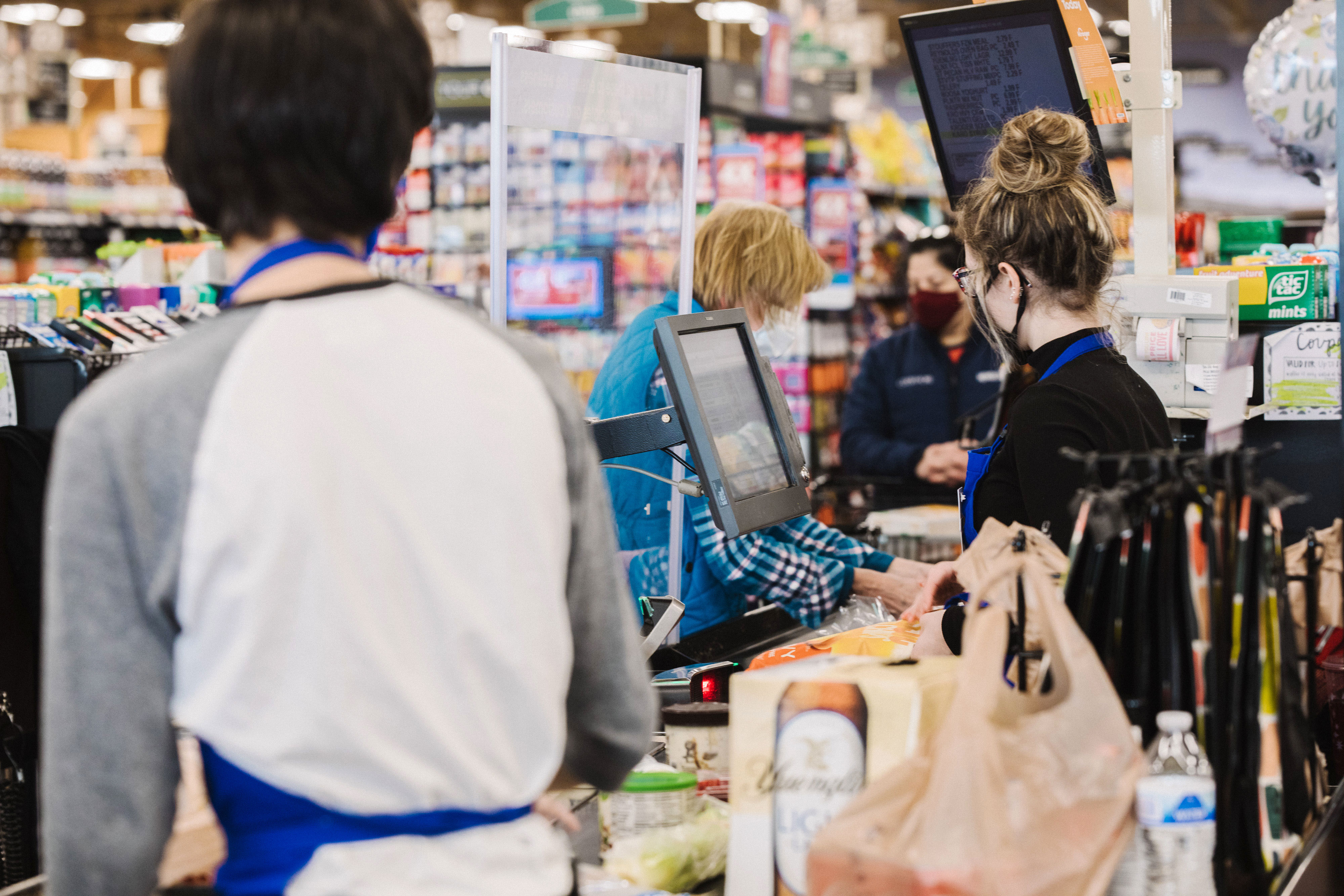A Kroger worker assists a customer at the checkout counter in Versailles, Kentucky, in November 2020.