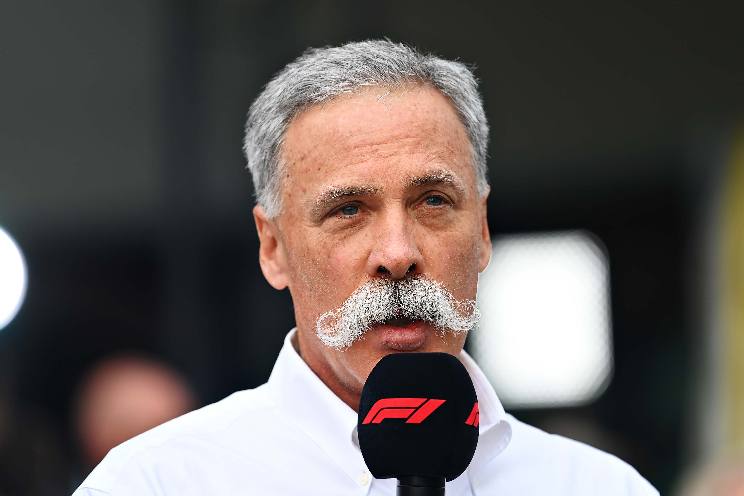 Formula One's Chief Executive Chase Carey speaks at a press conference in Melbourne, Australia, on March 13, after the F1 Grand Prix of Australia was cancelled.