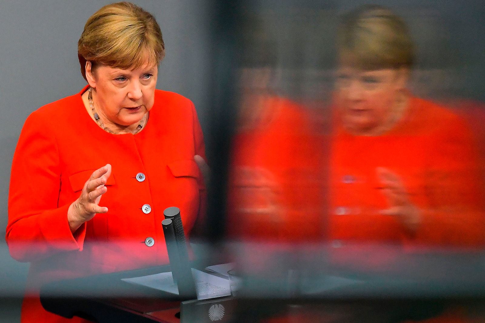 German Chancellor Angela Merkel speaks during a sitting of the Bundestag, Germany's lower house of parliament in Berlin on June 18.