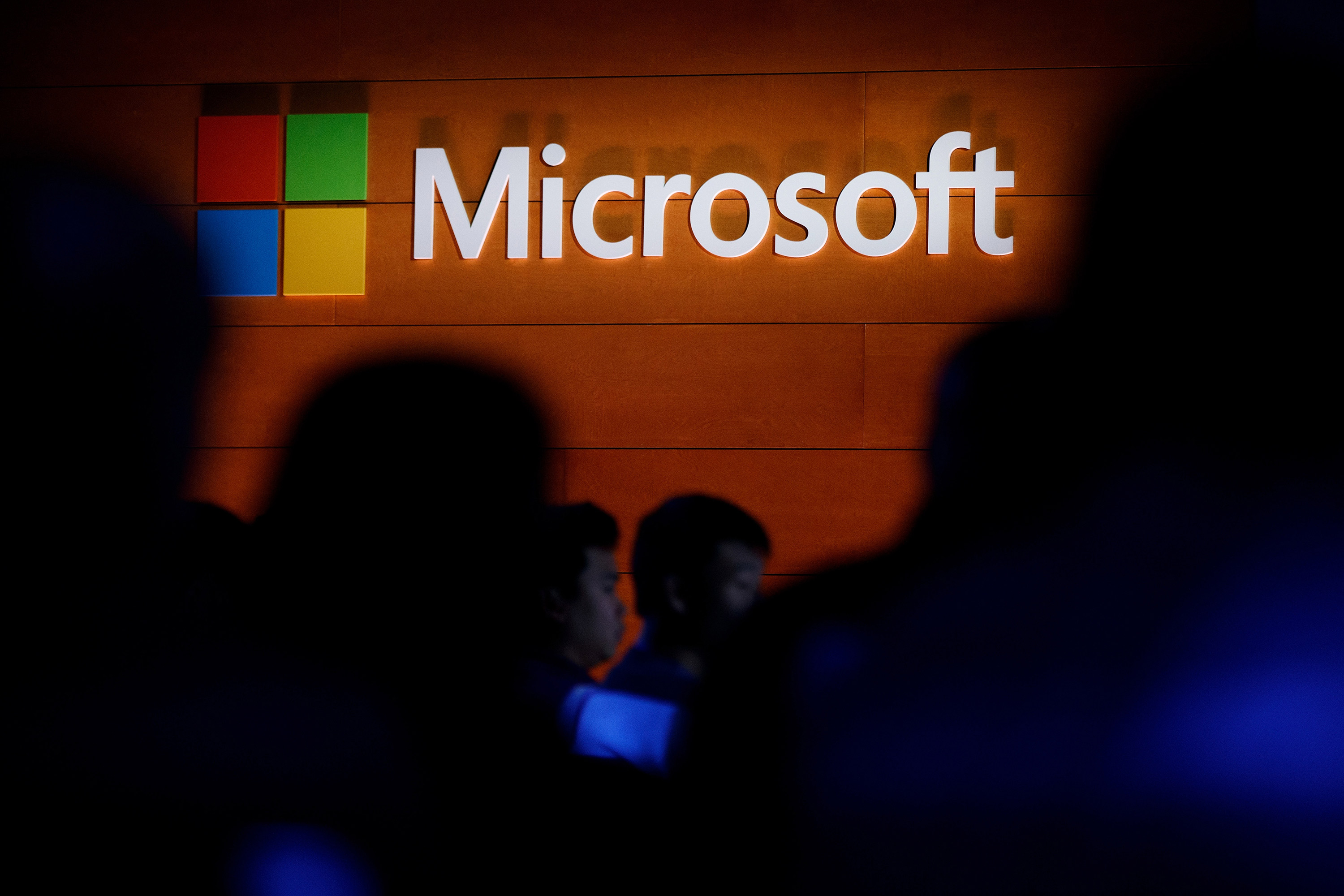 The Microsoft logo is illuminated on a wall on May 2, 2017 in New York.