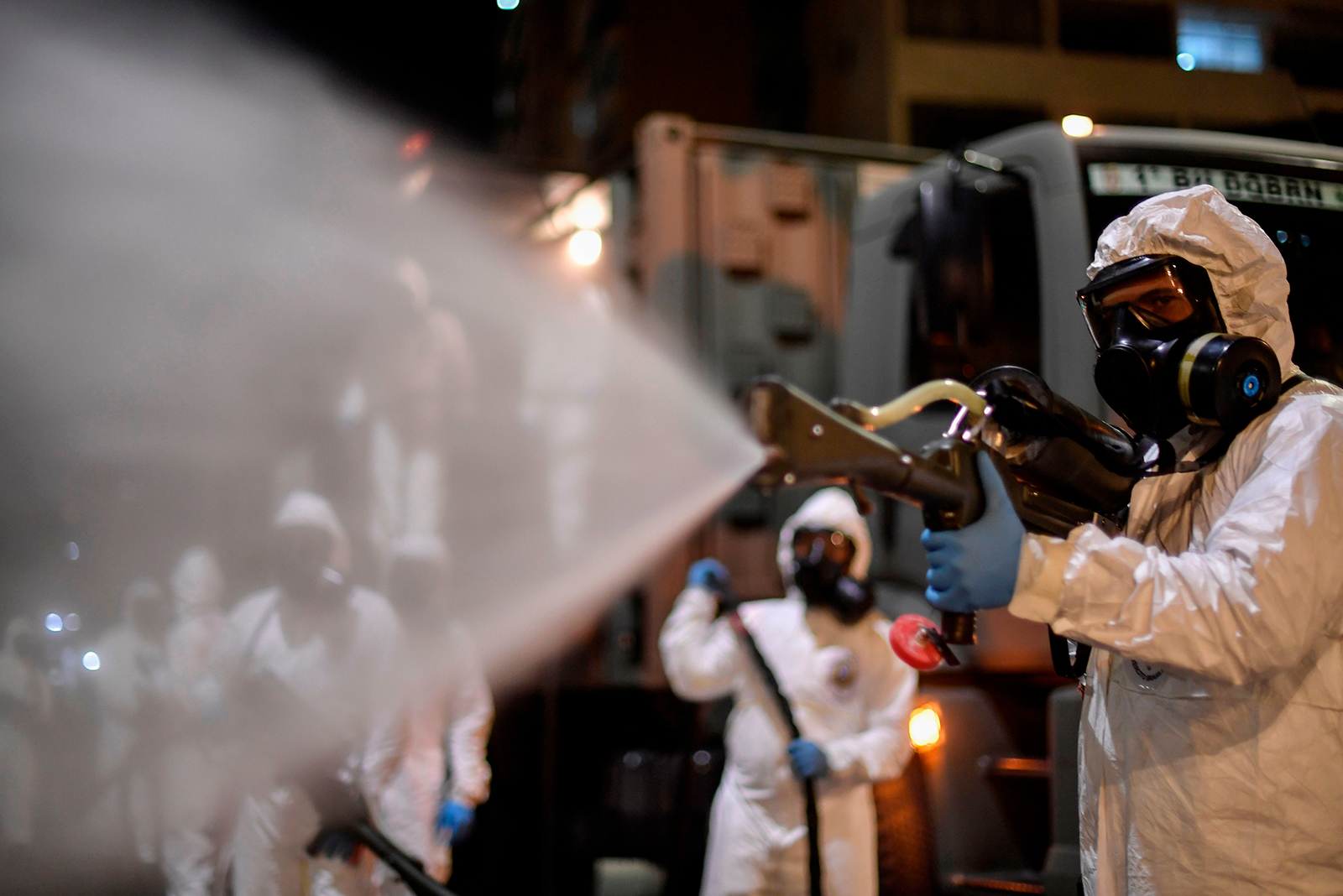 Soldiers from the 4th Military Region of the Brazilian Armed Forces are seen cleaning the outside as they take part in the cleaning and disinfection of the Municipal Market in the Belo Horizonte, state of Minas Gerais, Brazil on August 18.