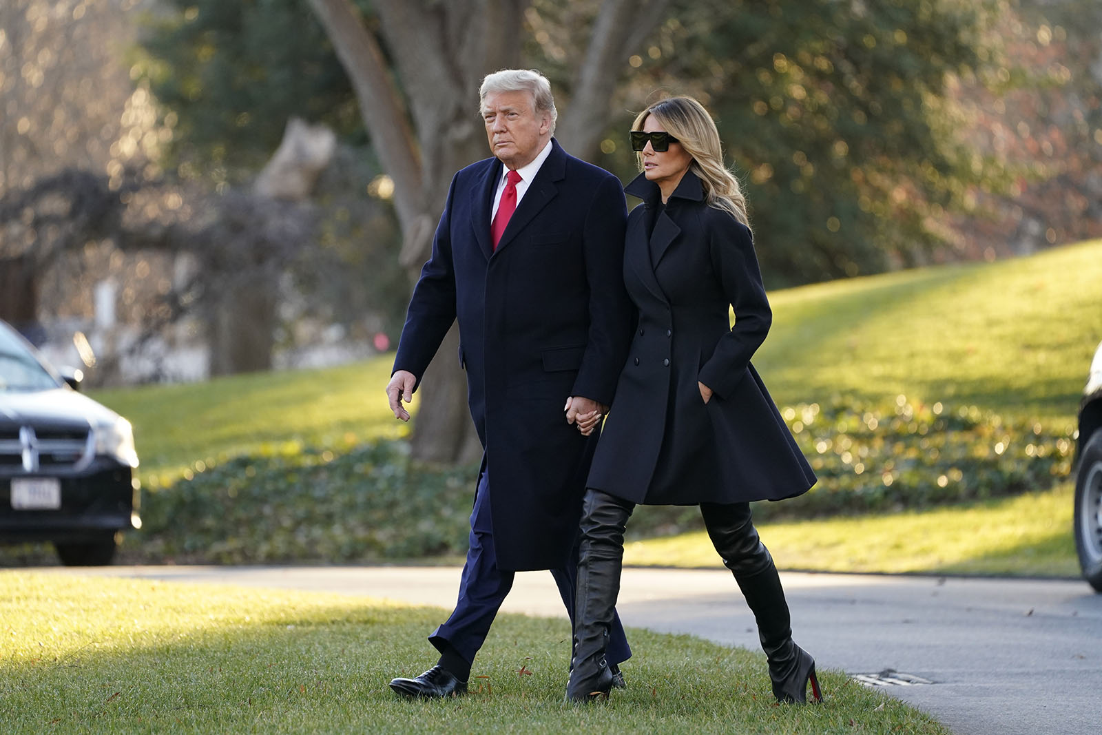 President Donald Trump and first lady Melania Trump walk to board Marine One on the South Lawn of the White House on Wednesday in Washington.
